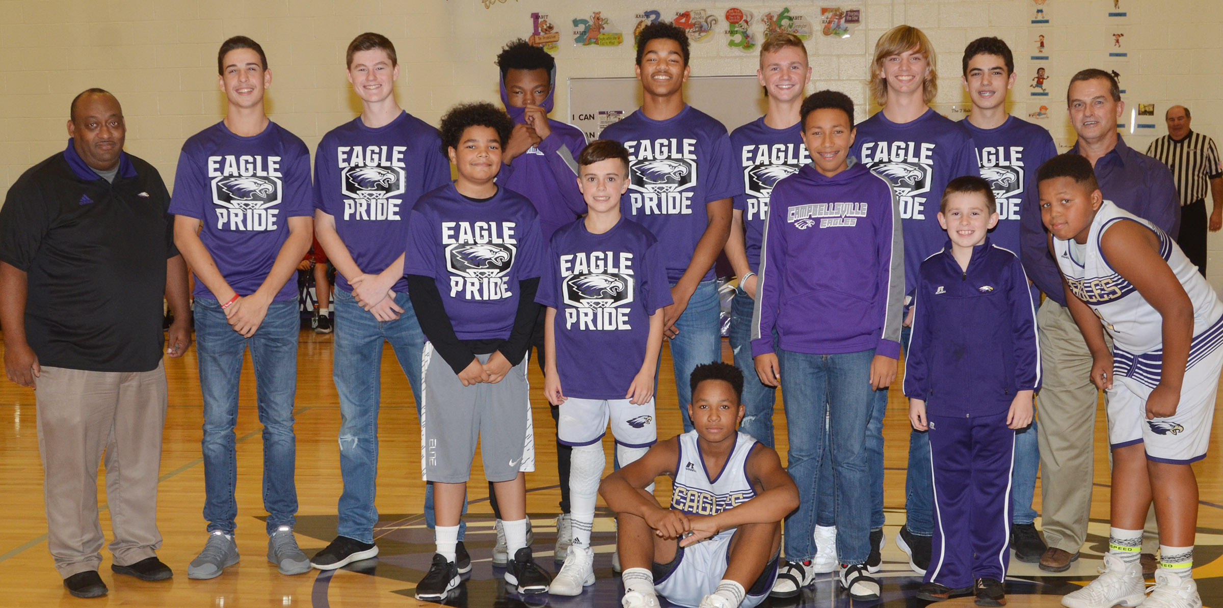 Members of the CMS undefeated 2016-2017 boys' basketball team who won the CKMSAC regular season and tournament championships are honored.