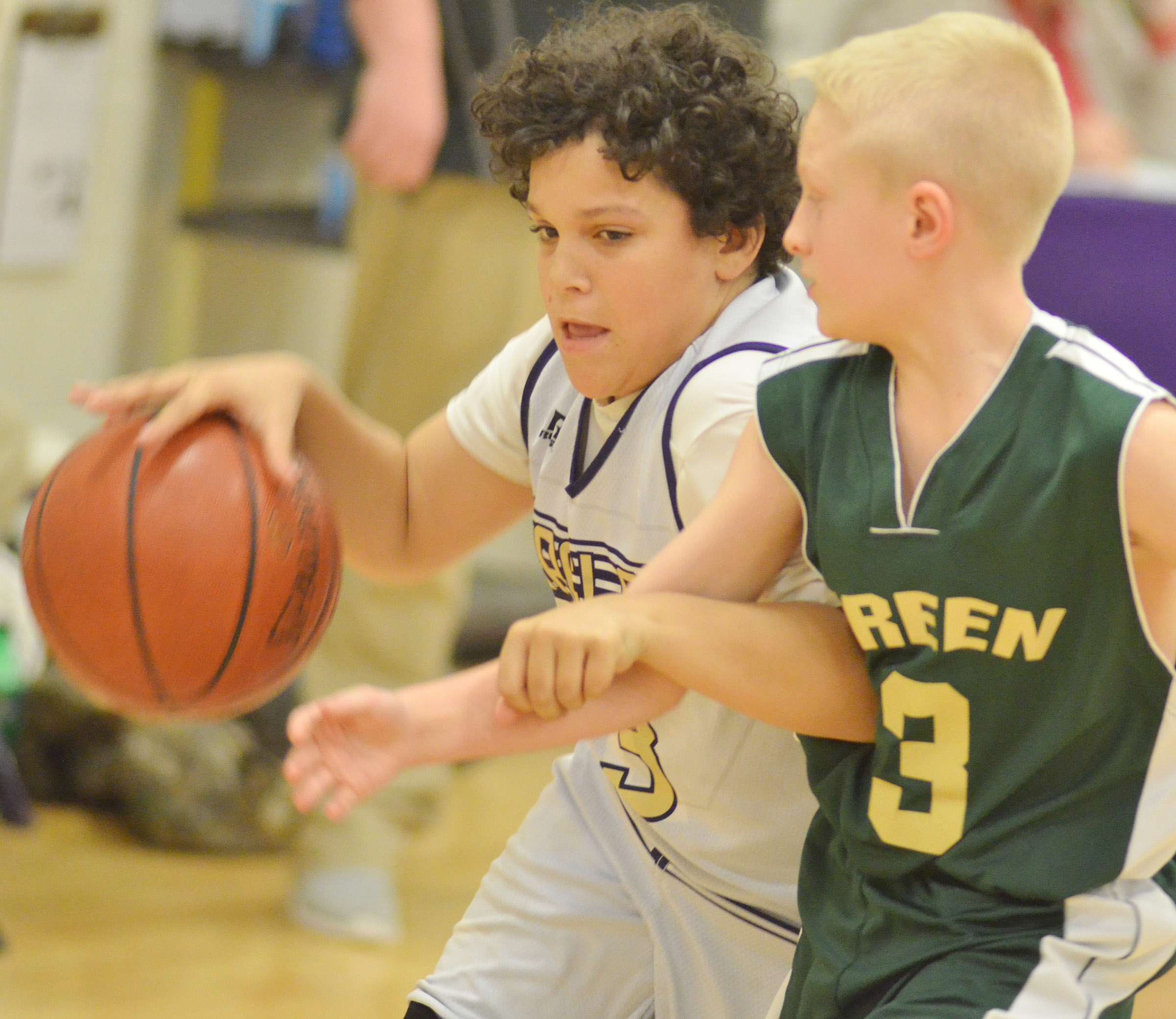 CMS seventh-grader Kaydon Taylor dribbles to the hoop.
