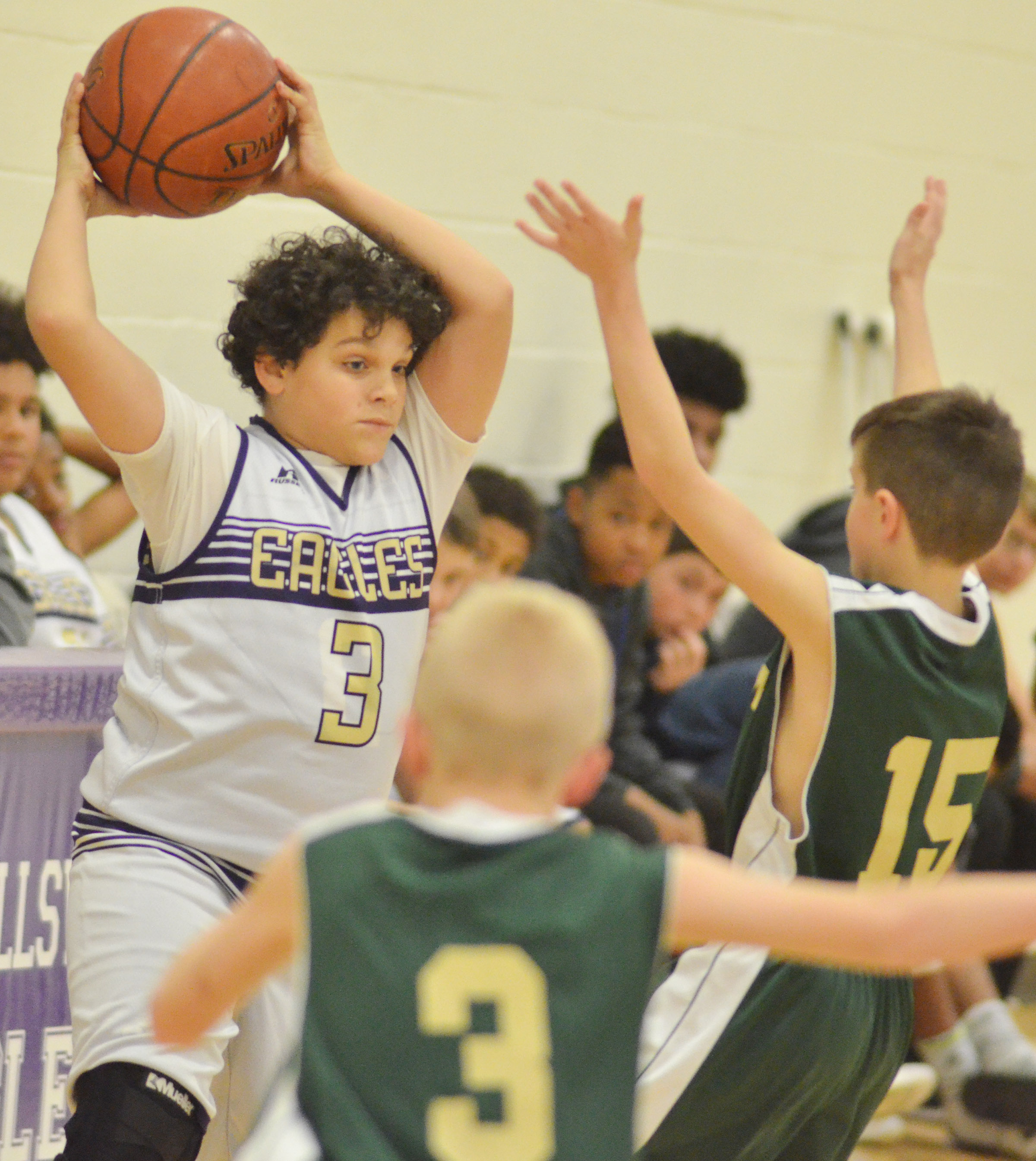 CMS seventh-grader Kaydon Taylor looks for a teammate.