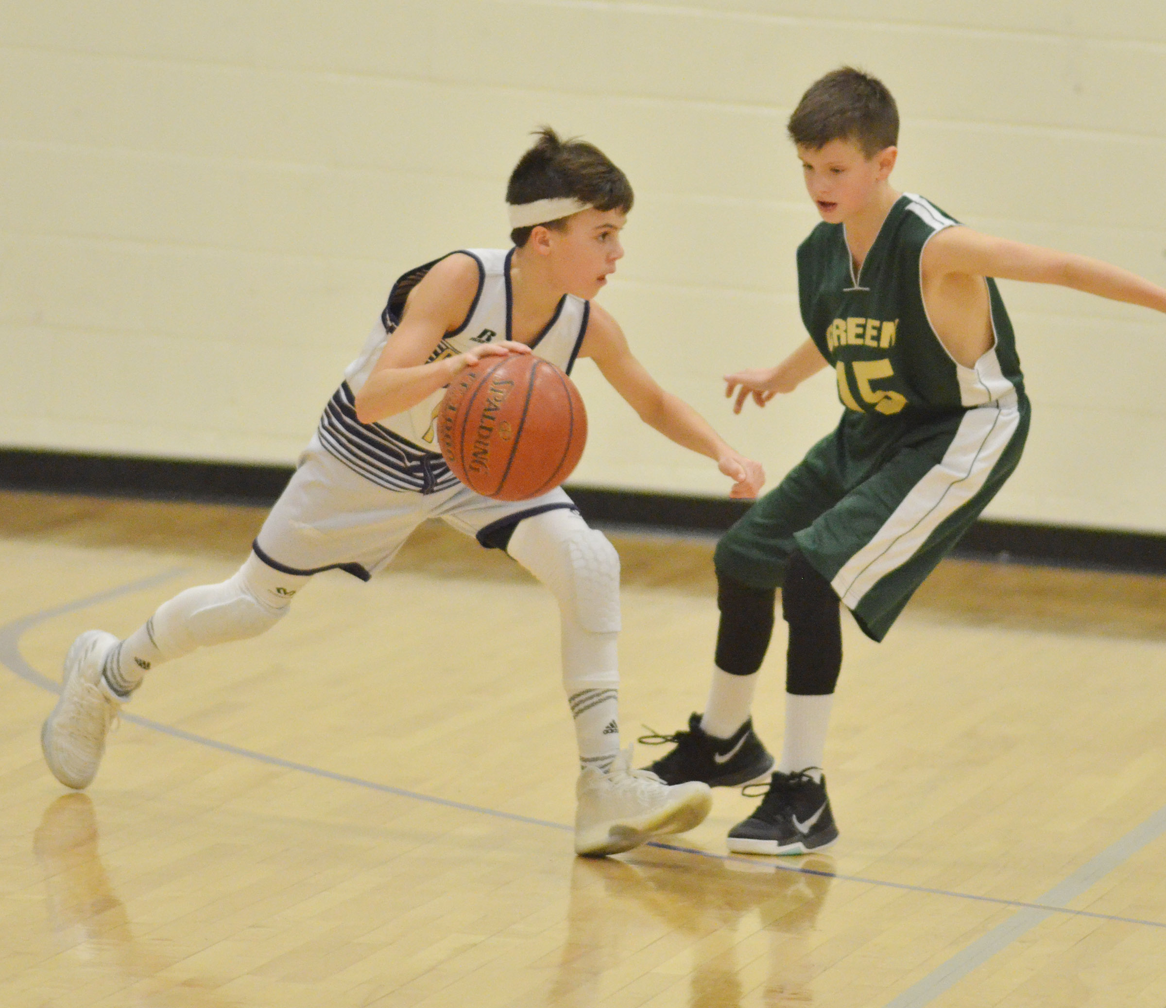 CMS seventh-grader Chase Hord drives the ball for two points.