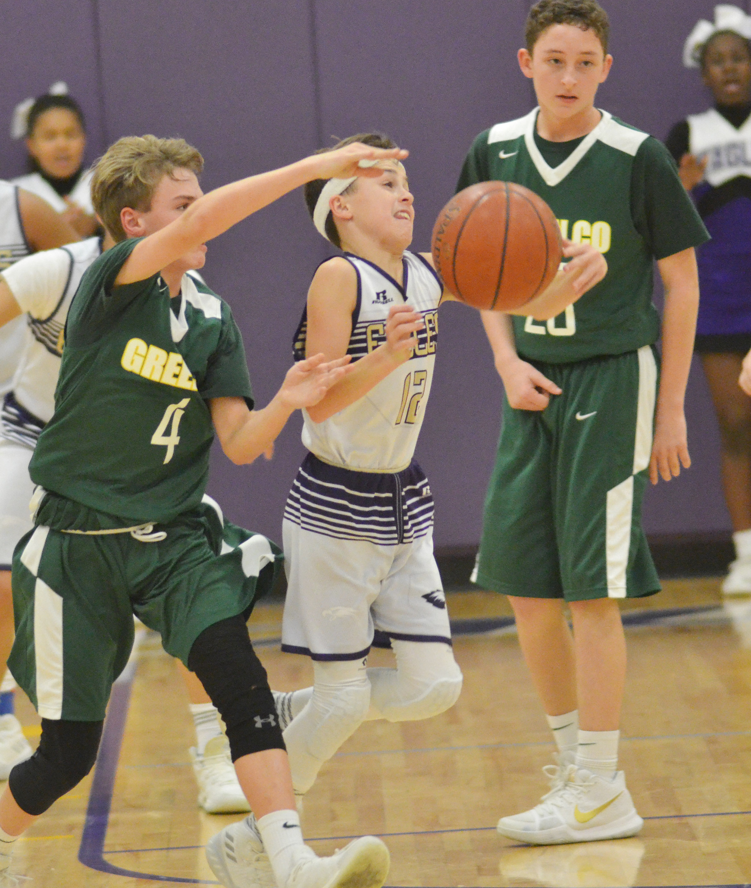 CMS seventh-grader Chase Hord tries to hold on as the ball gets away from him.
