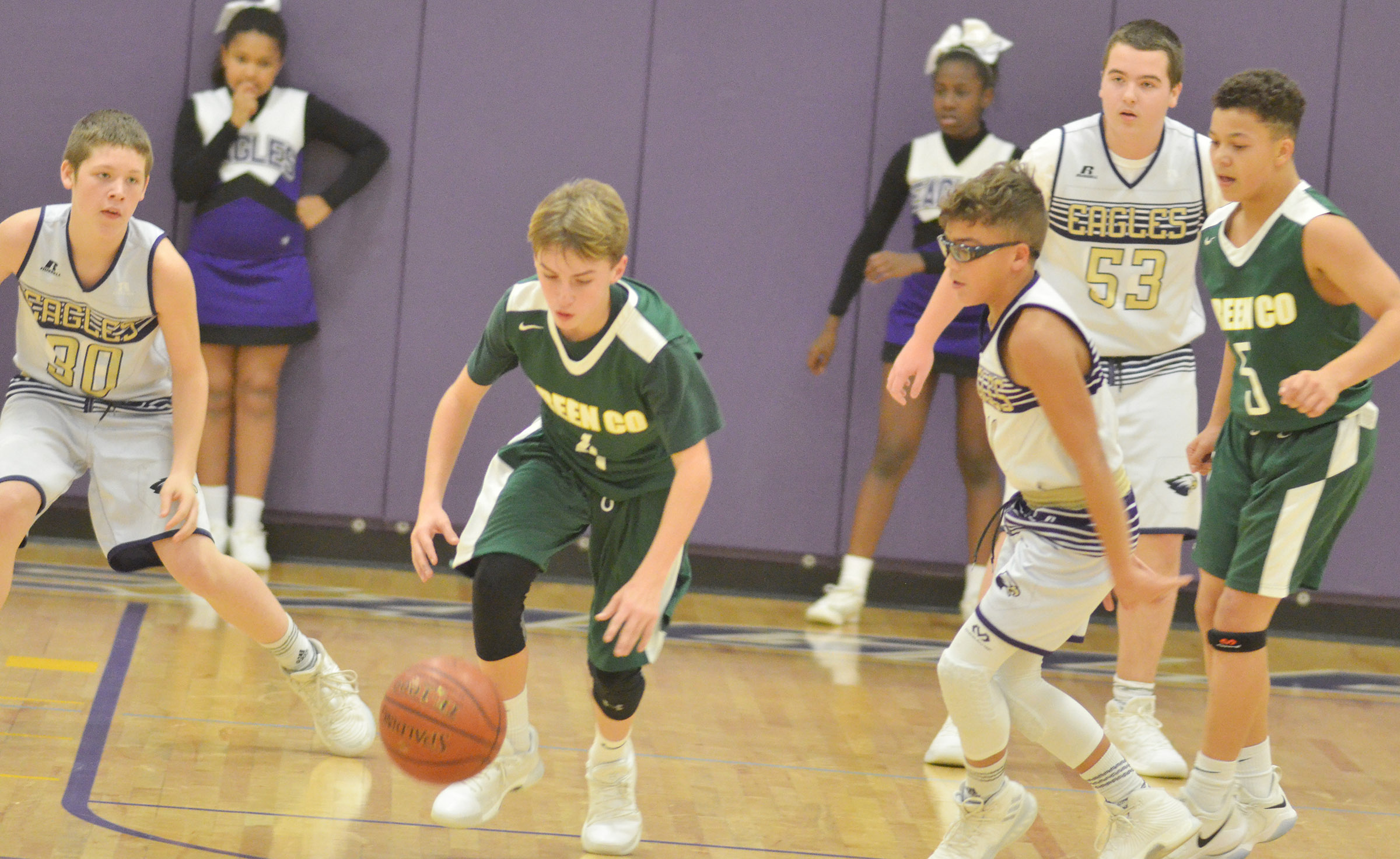 From left, CMS eighth-graders Josh Lucas, Logan Phillips and Jack Sabo run for the ball.