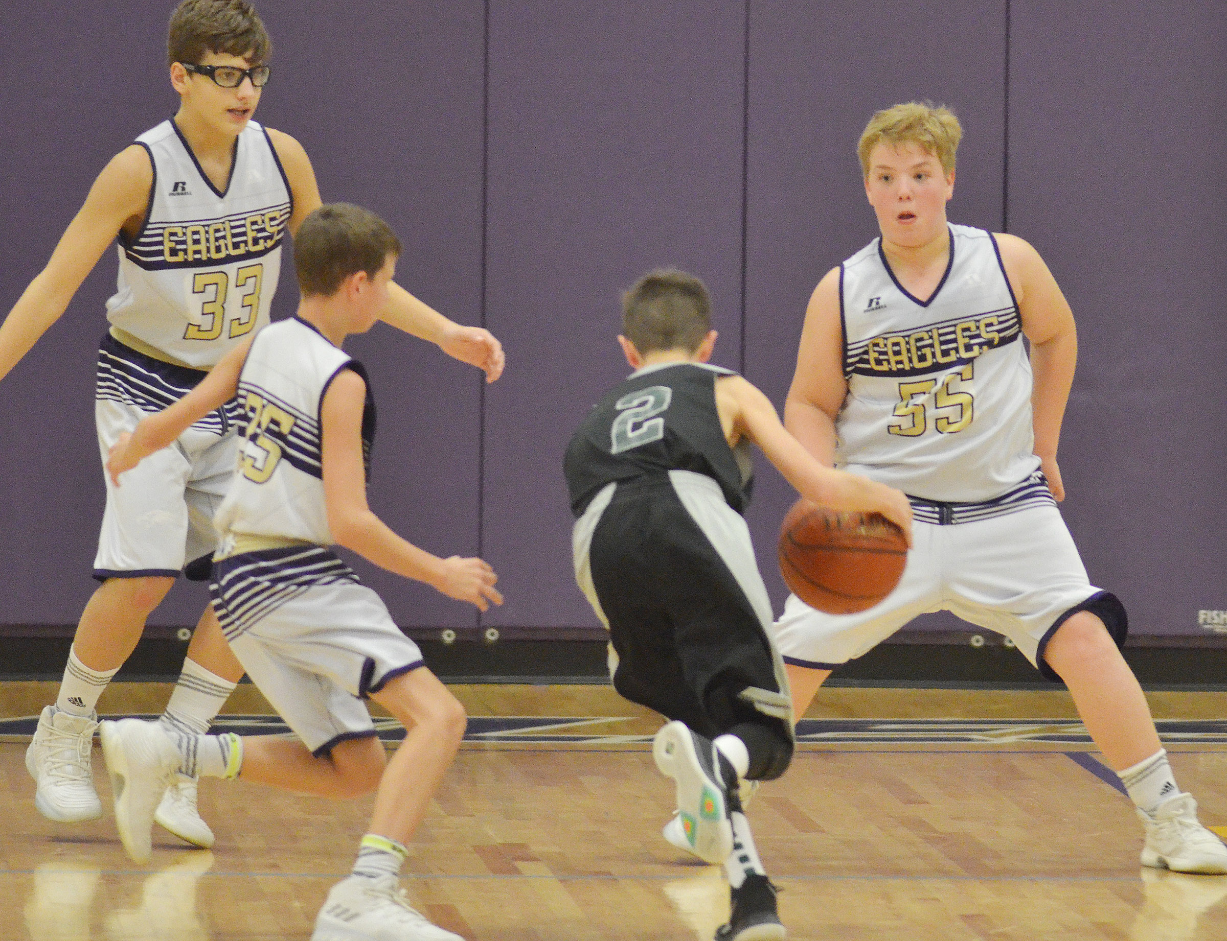 From left, Campbellsville Elementary School fifth-graders Dalton Morris and Rowan Petett and CMS sixth-grader Ryan Grubbs play defense.
