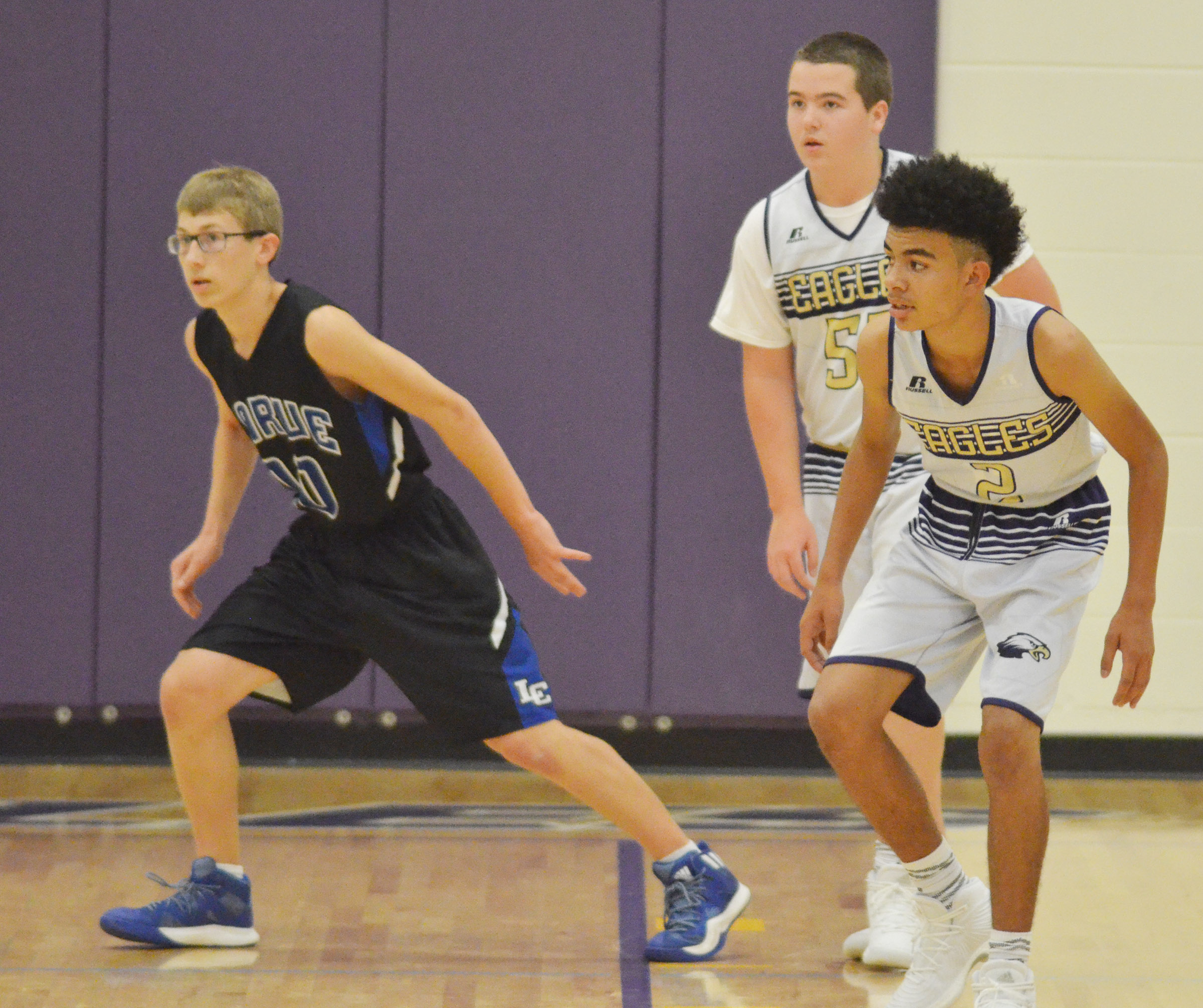 CMS eighth-graders Jack Sabo, at left, and Adrien Smith play defense.