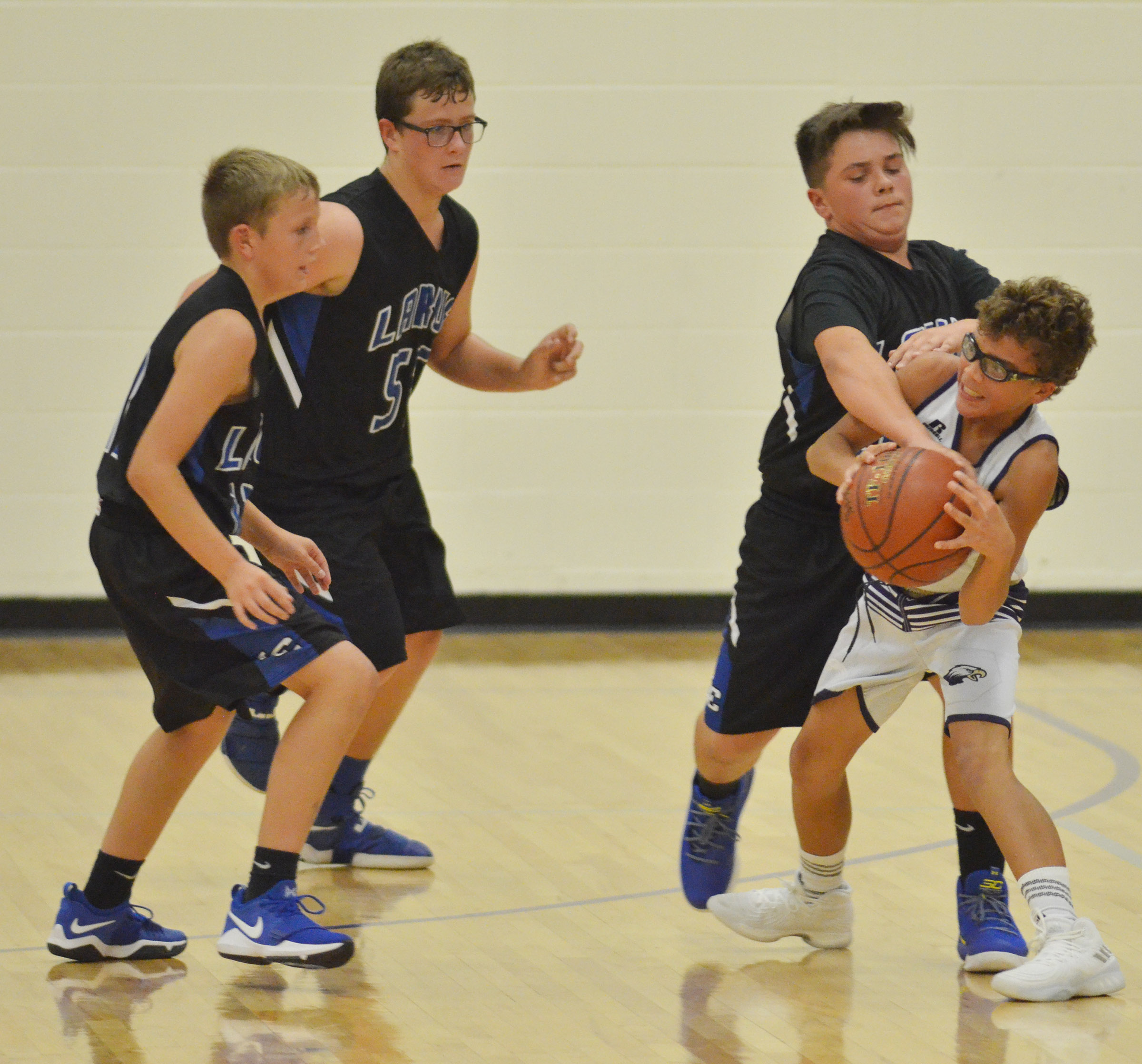 CMS eighth-grader Logan Phillips protects the ball.
