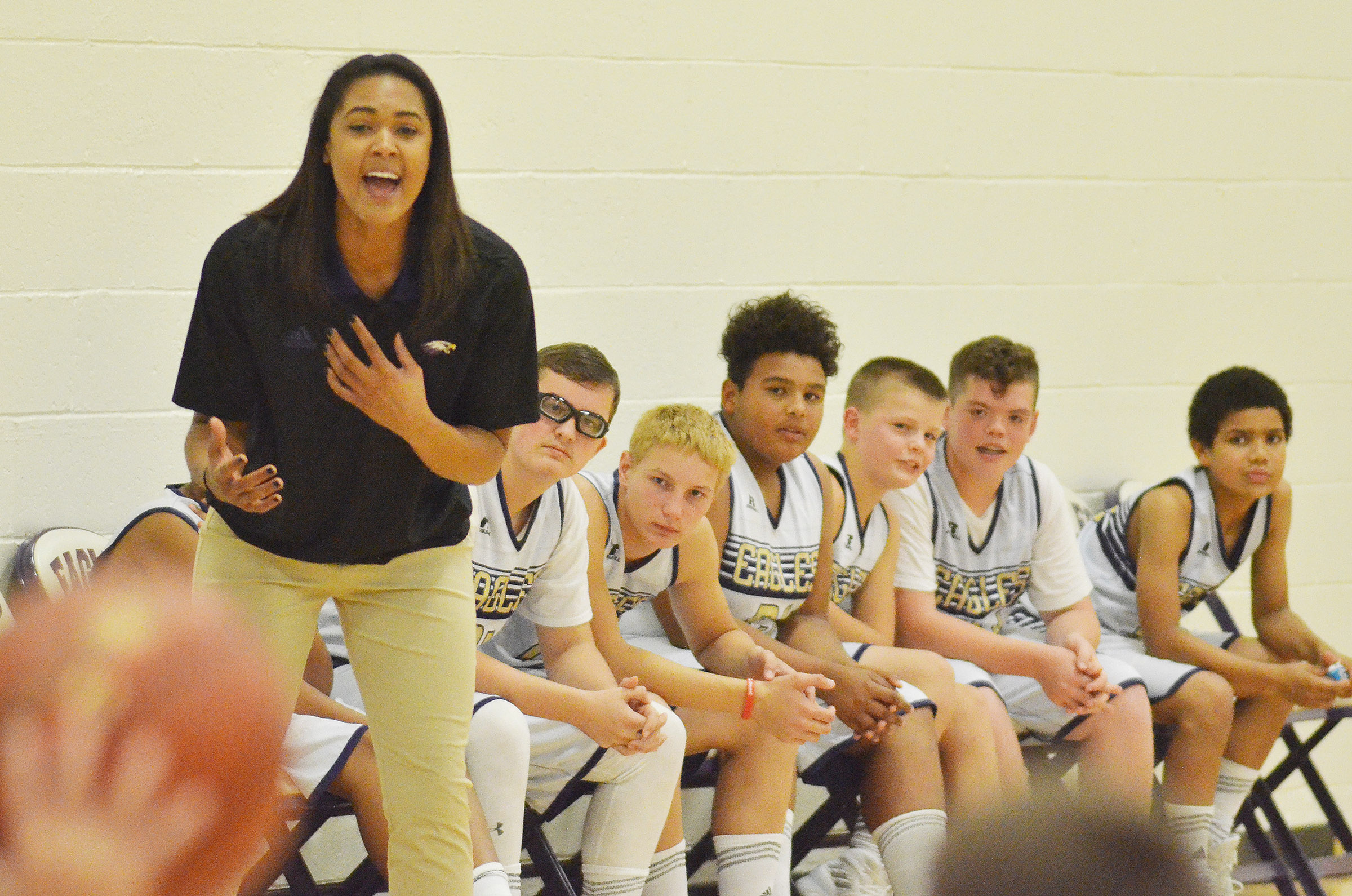 CMS boys' basketball assistant coach Kyvin Goodin-Rogers yells to her players.