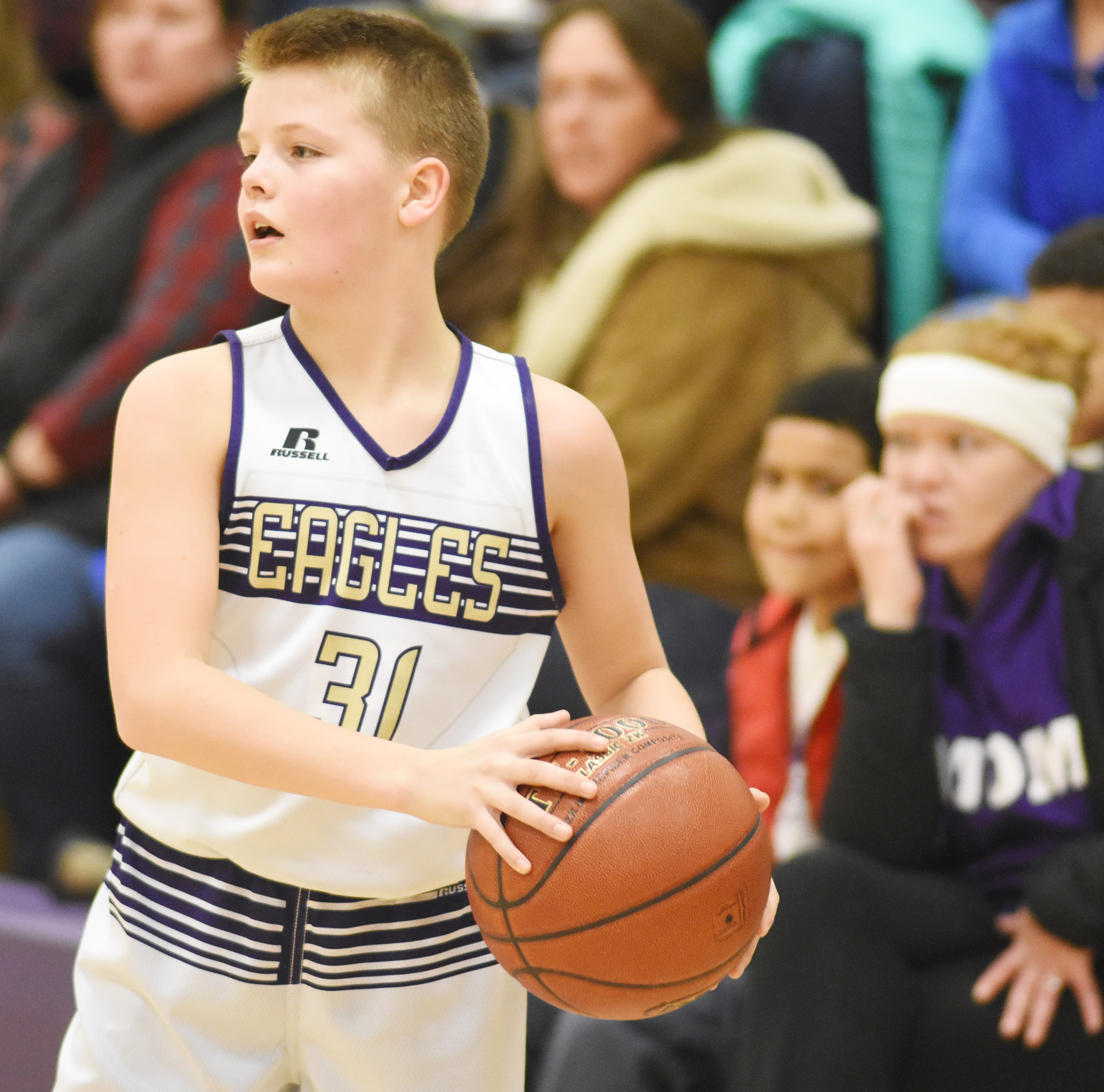 CMS seventh-grader Konner Forbis looks to pass.