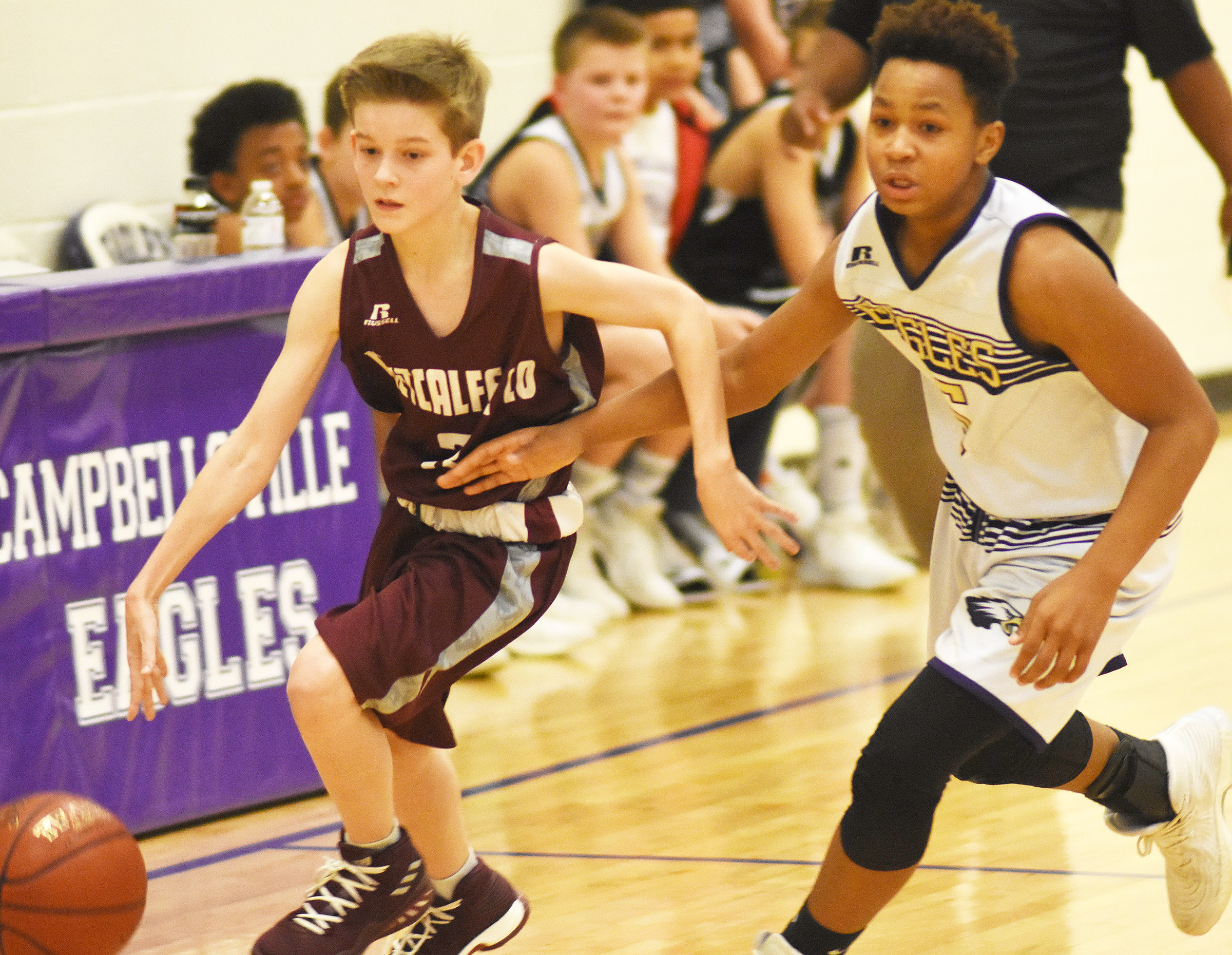CMS seventh-grader Deondre Weathers plays defense.