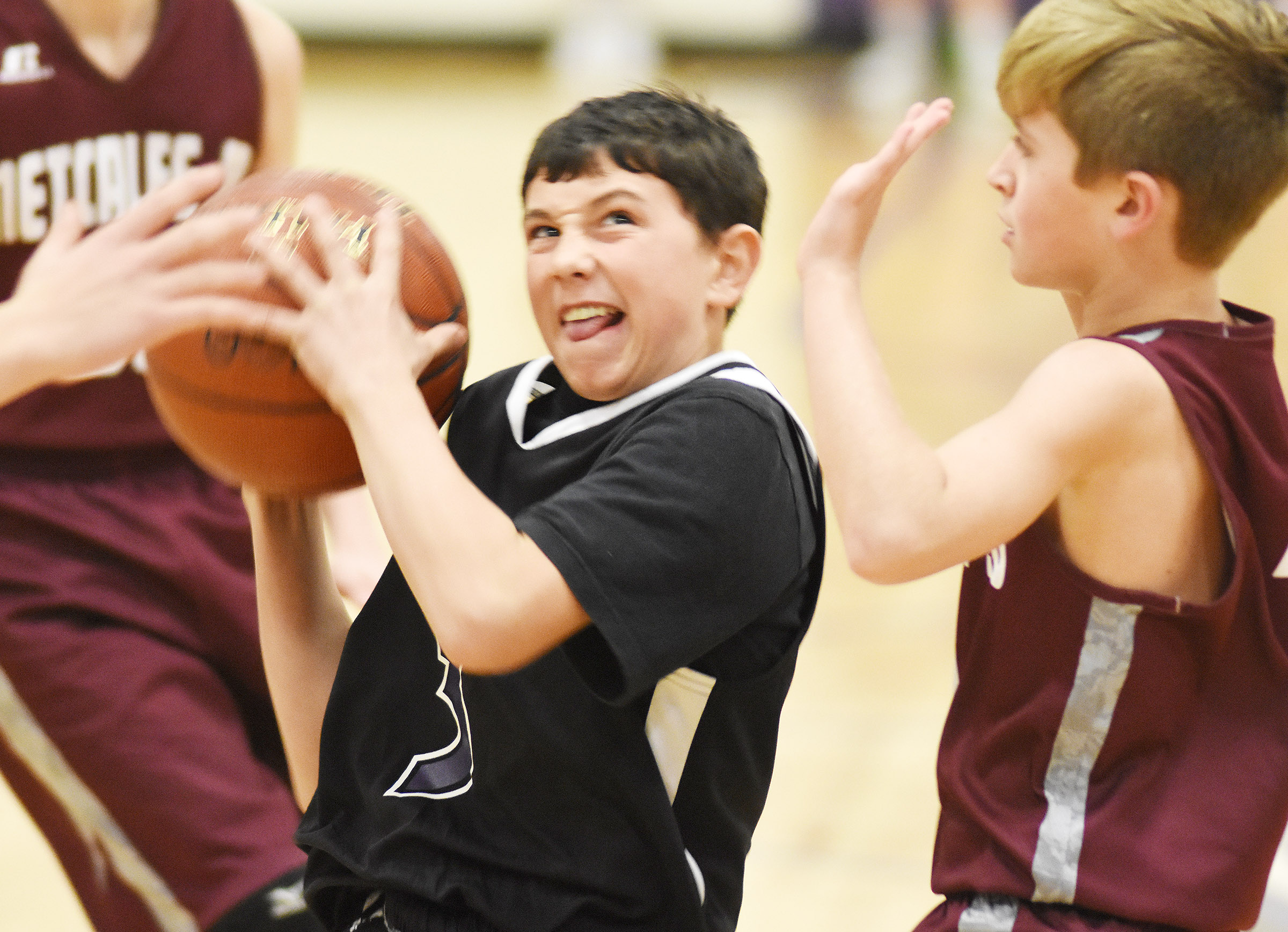 CMS eighth-grader Dakota Harris drives the ball to the basket.