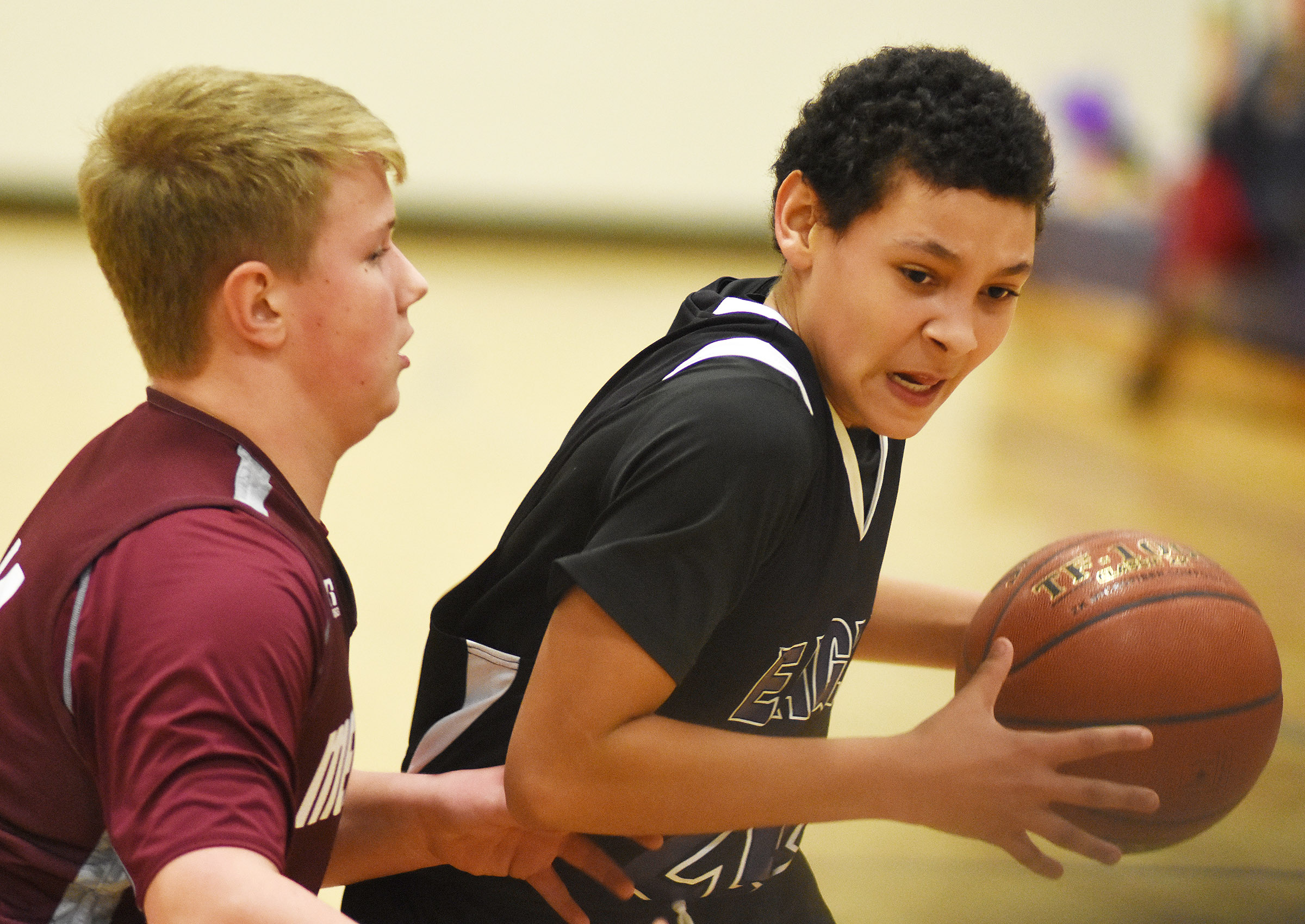 CMS eighth-grader Brice Spaw drives the ball to the basket.