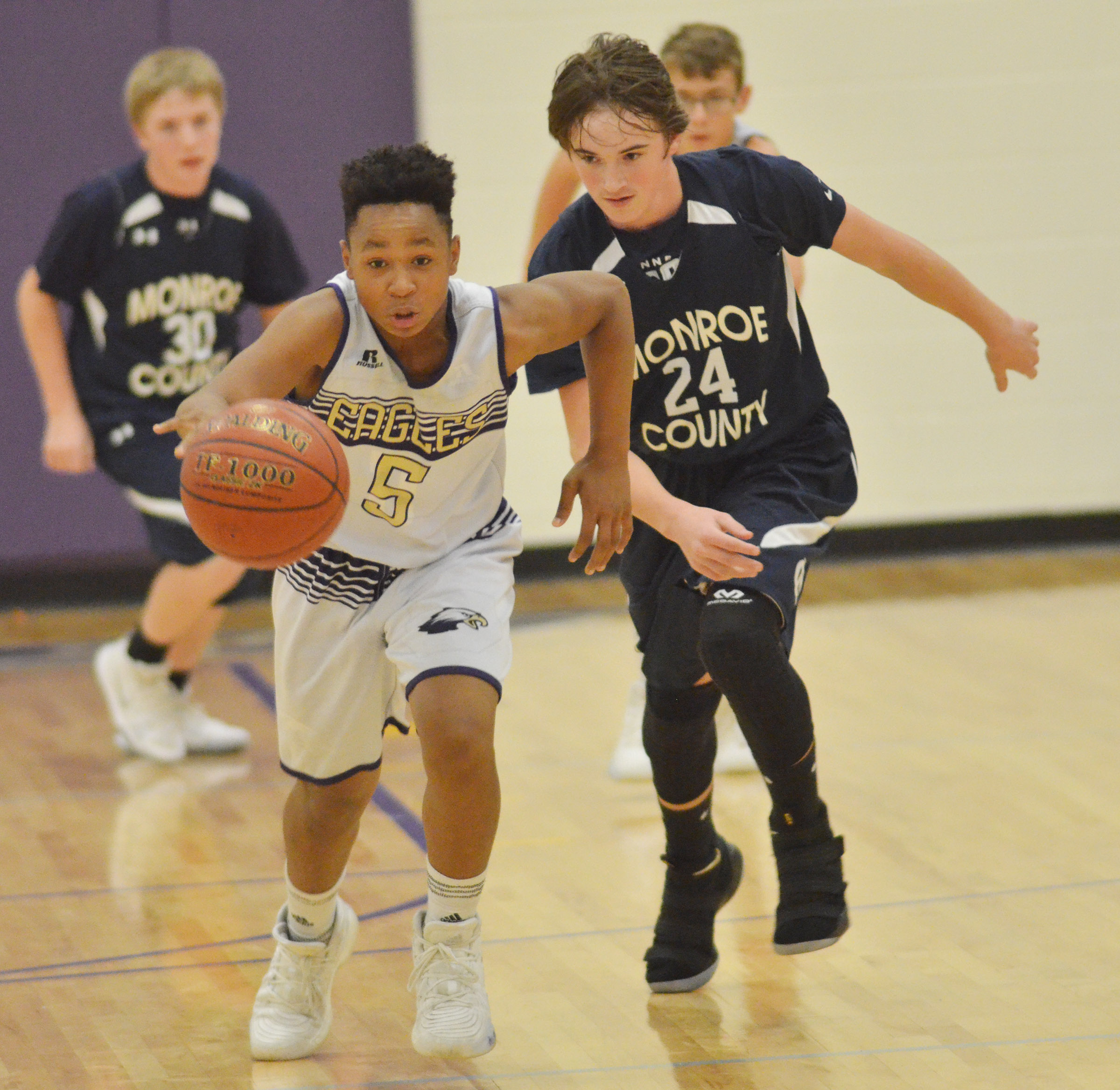 CMS seventh-grader Deondre Weathers steals the ball.
