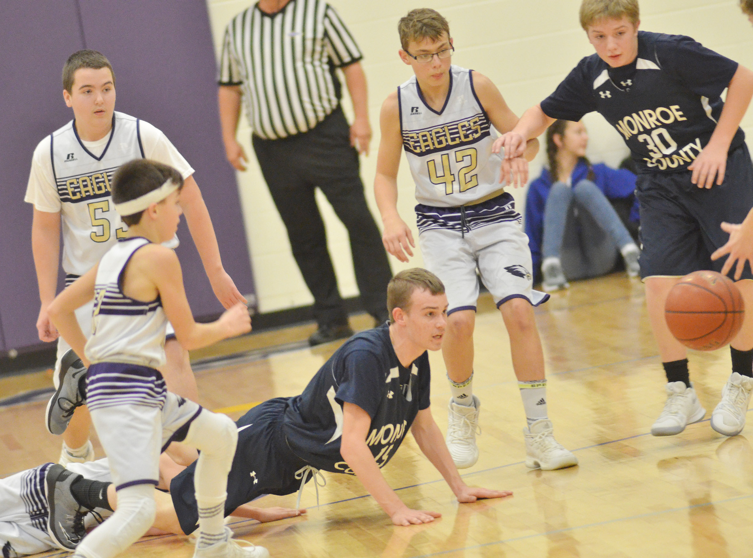 From left, CMS seventh-grader Chase Hord and eighth-graders Jack Sabo and Jarred Mays run for the ball.