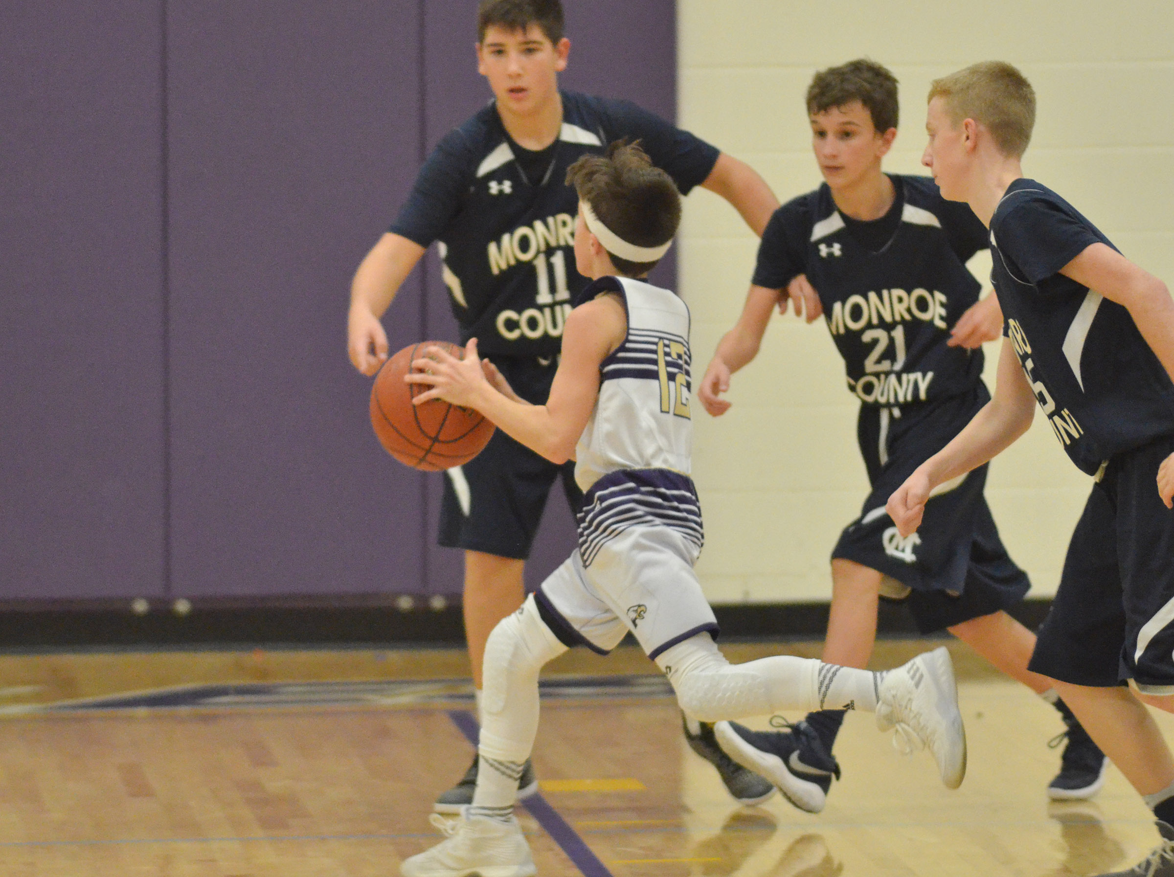 CMS seventh-grader Chase Hord drives the ball to the basket.