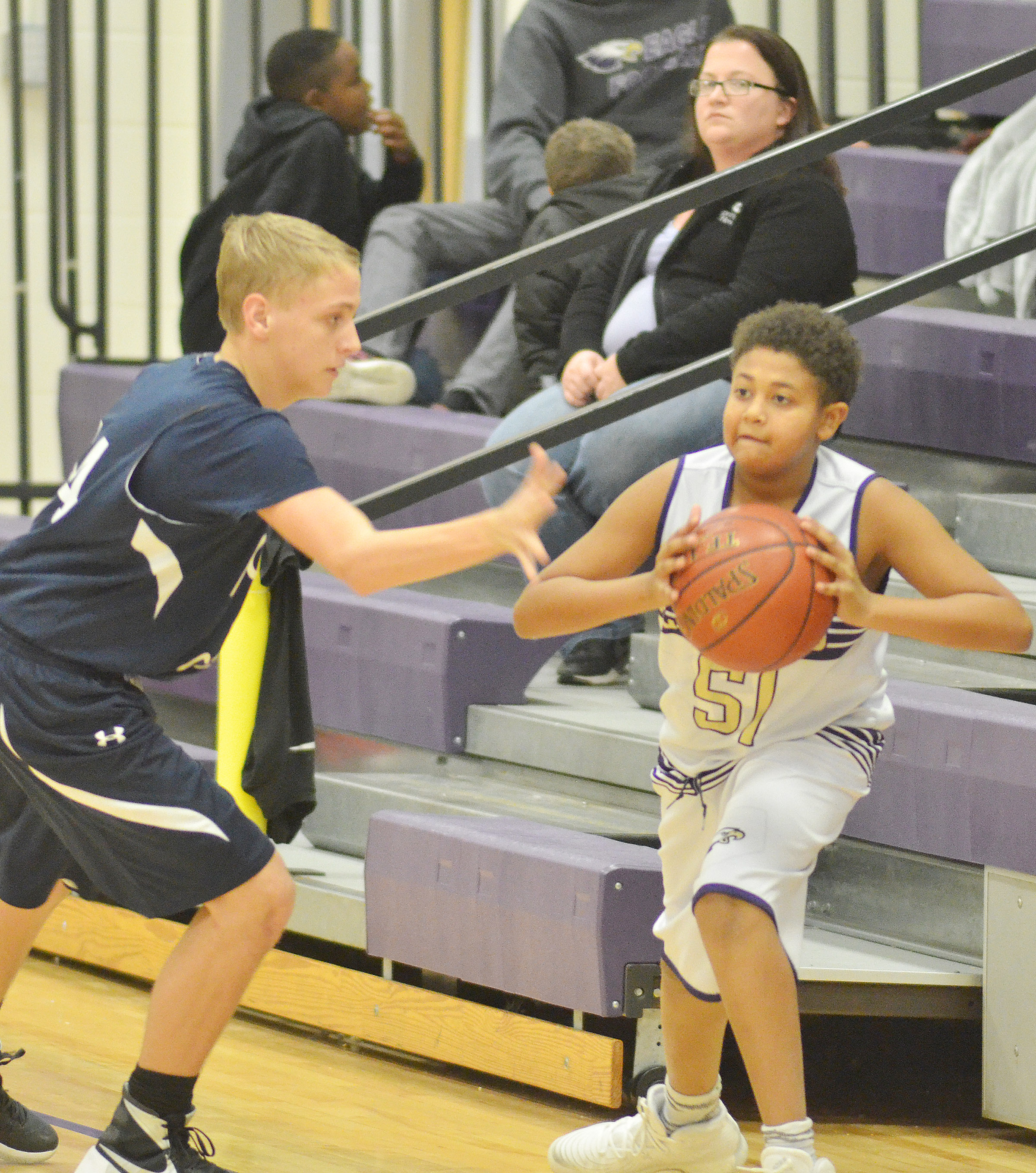 CMS seventh-grader Ronin Smith passes the ball.