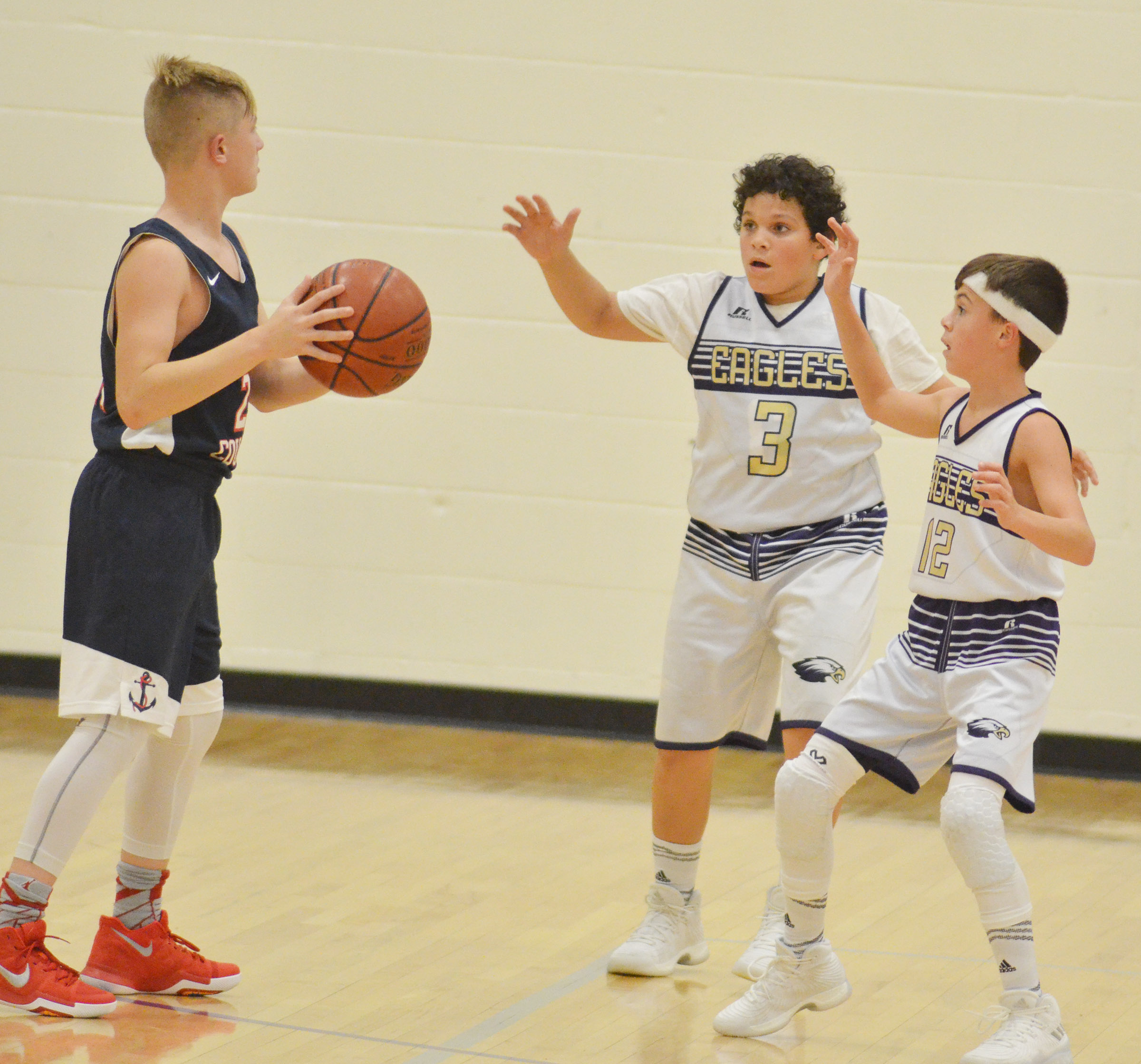 CMS seventh-graders Kaydon Taylor, at left, and Chase Hord play defense.