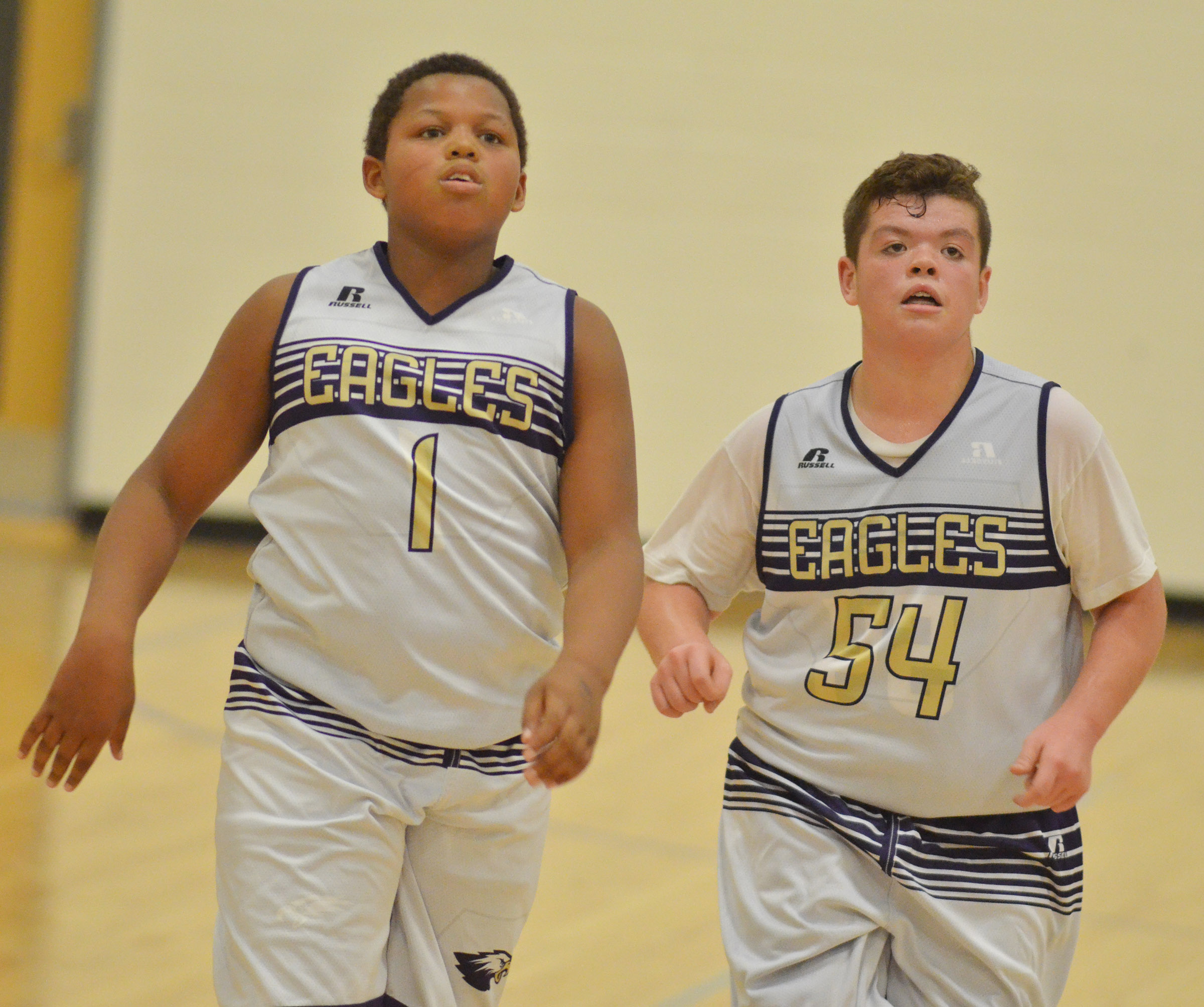 CMS seventh-graders Keondre Weathers, at left, and Hayden Jones run down the court.