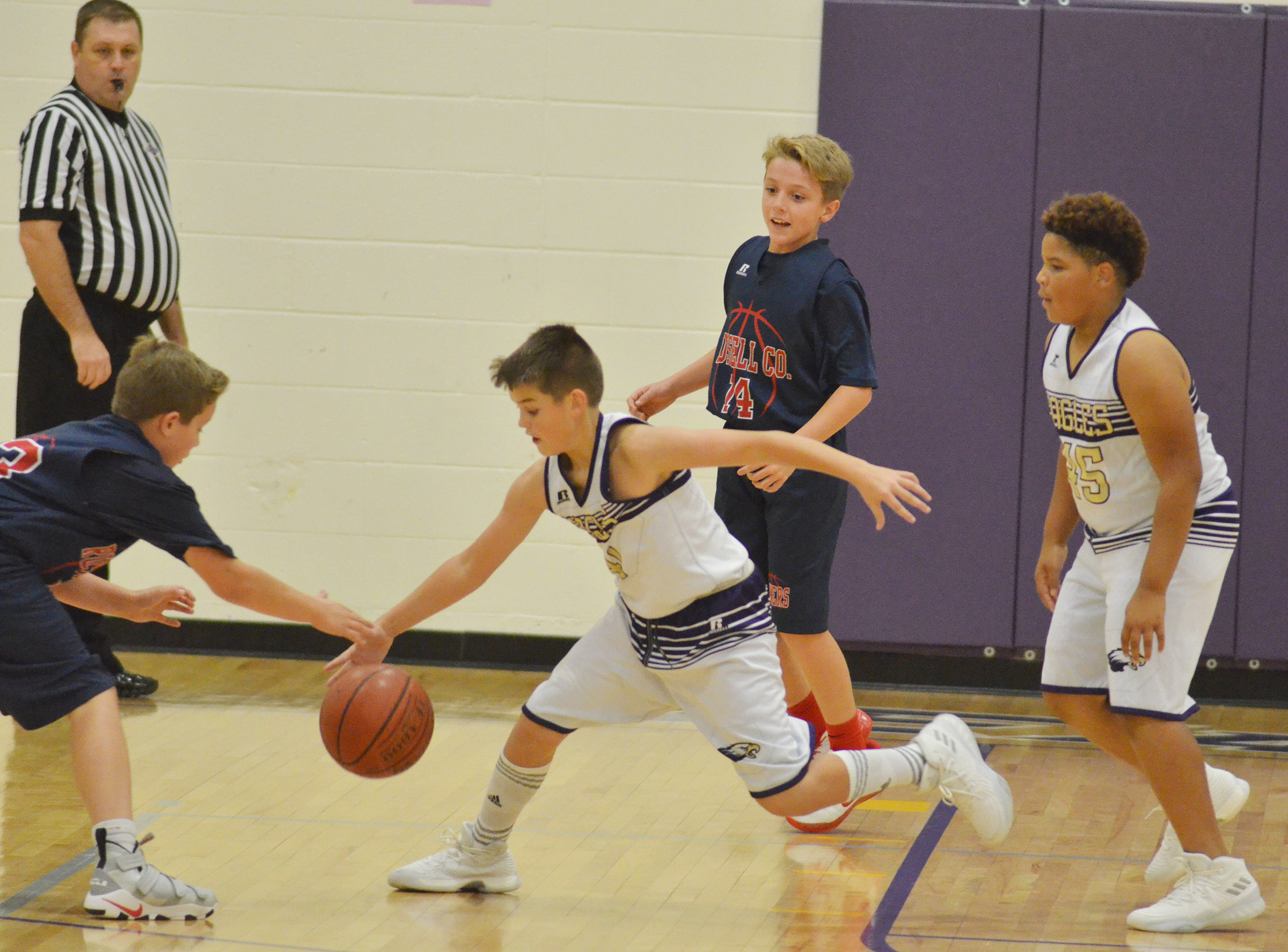 CMS sixth-graders Kaden Bloyd, at left, and Devin Kinser play defense.