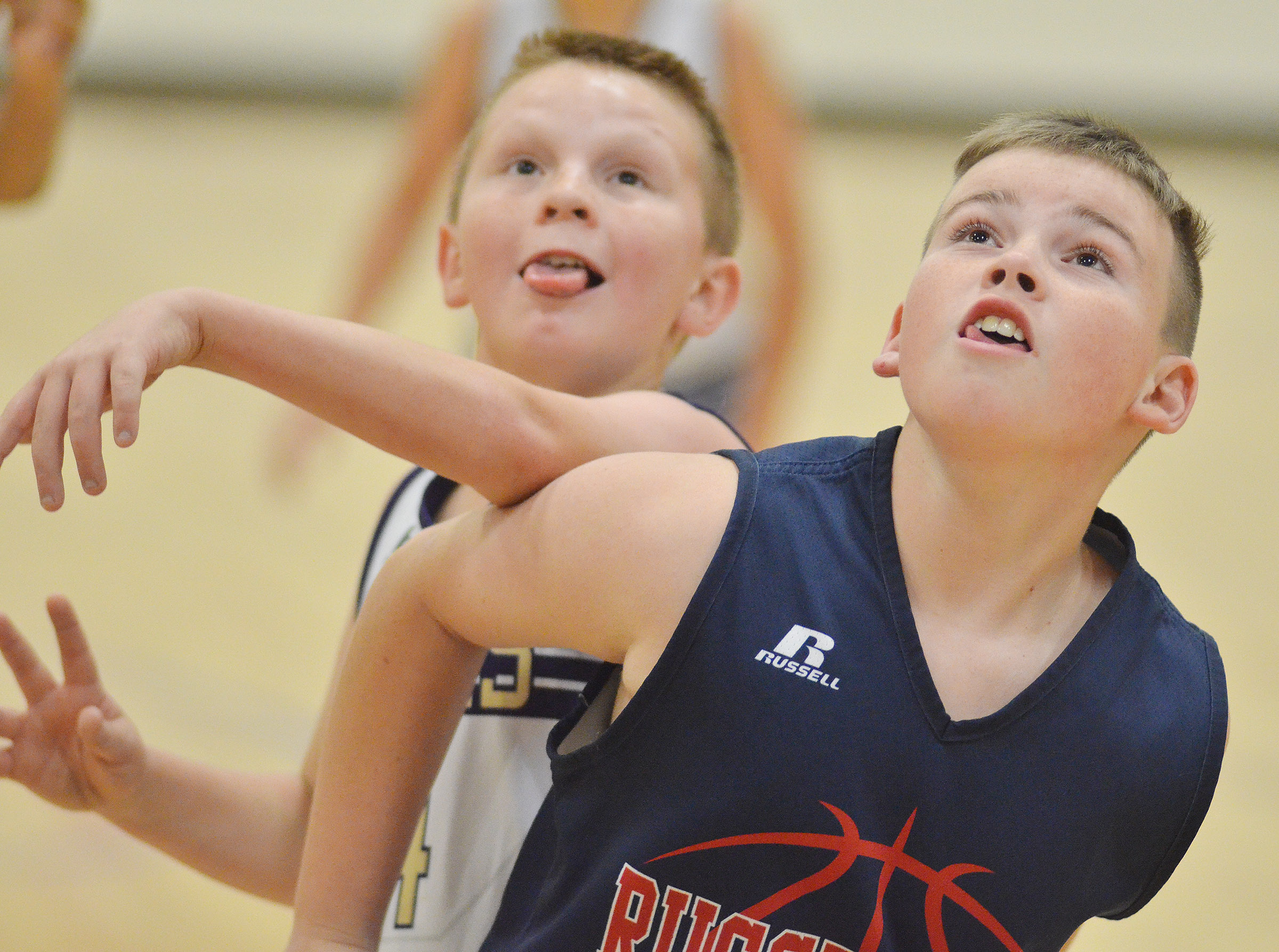 "CMS sixth-grader Jason ""Junior"" Jeffries battles for a rebound."