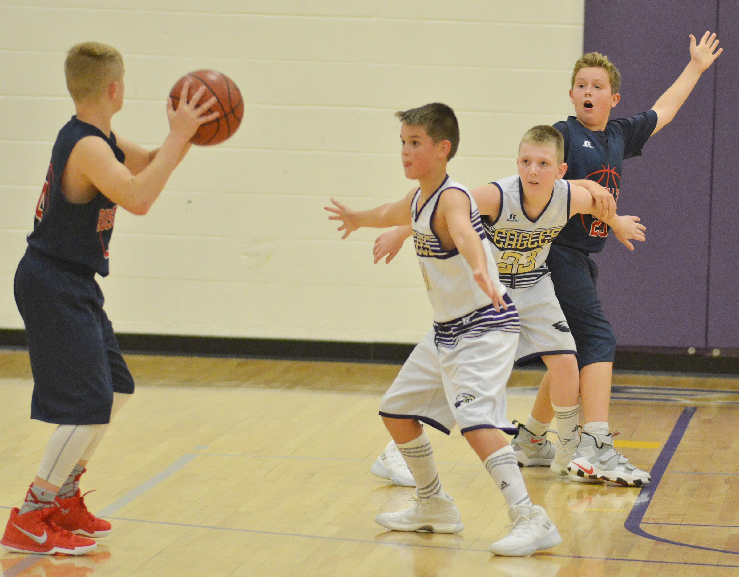 CMS sixth-grader Kaden Bloyd, at left, and Campbellsville Elementary School fifth-grader Kaleb Miller play defense.