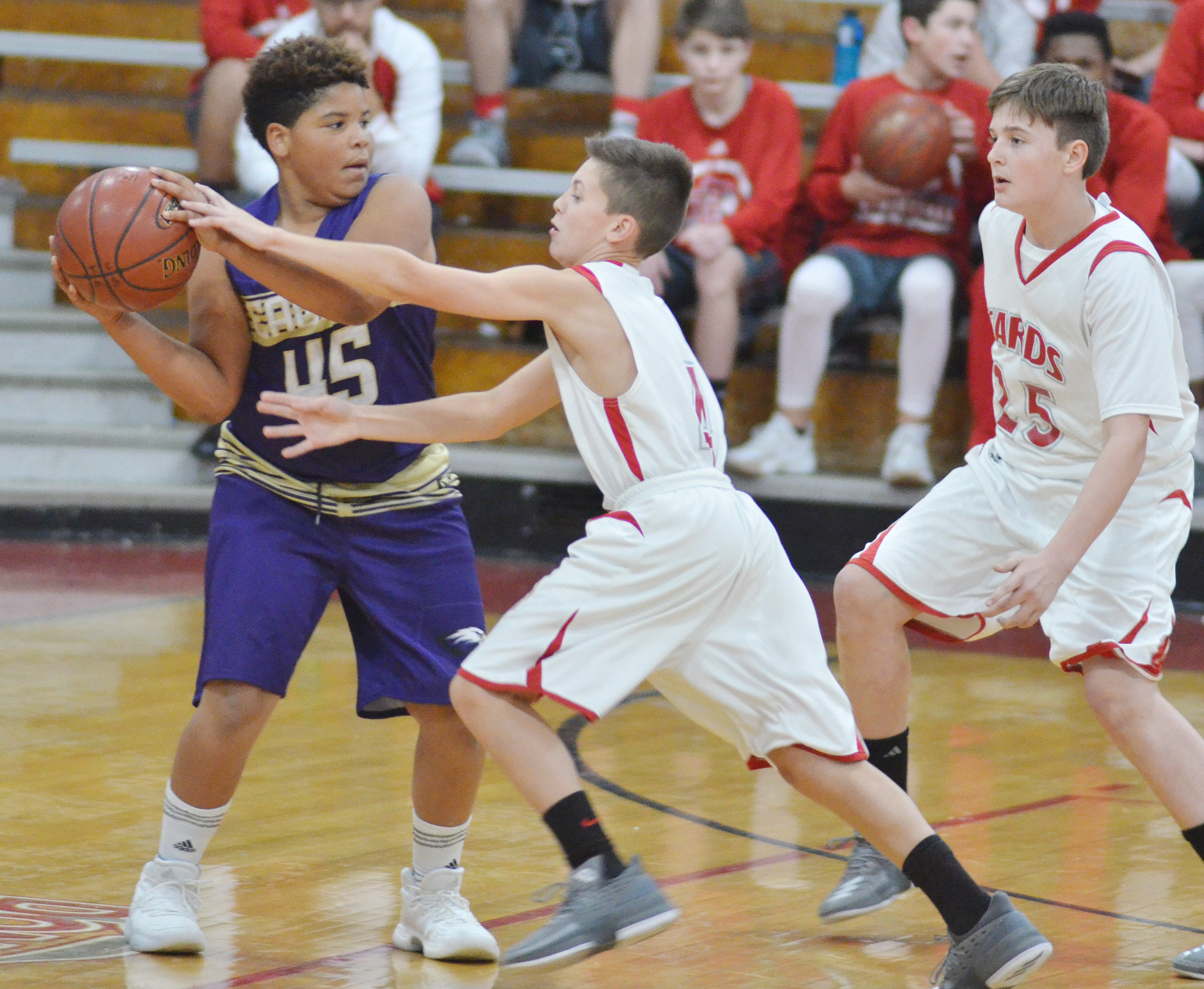 CMS sixth-grader Devin Kinser protects the ball.