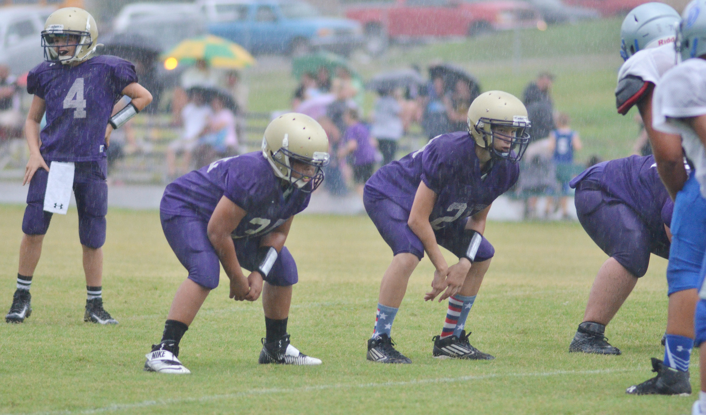 CMS seventh-grader Konner Forbis, at left, looks for the play as his teammates get set.