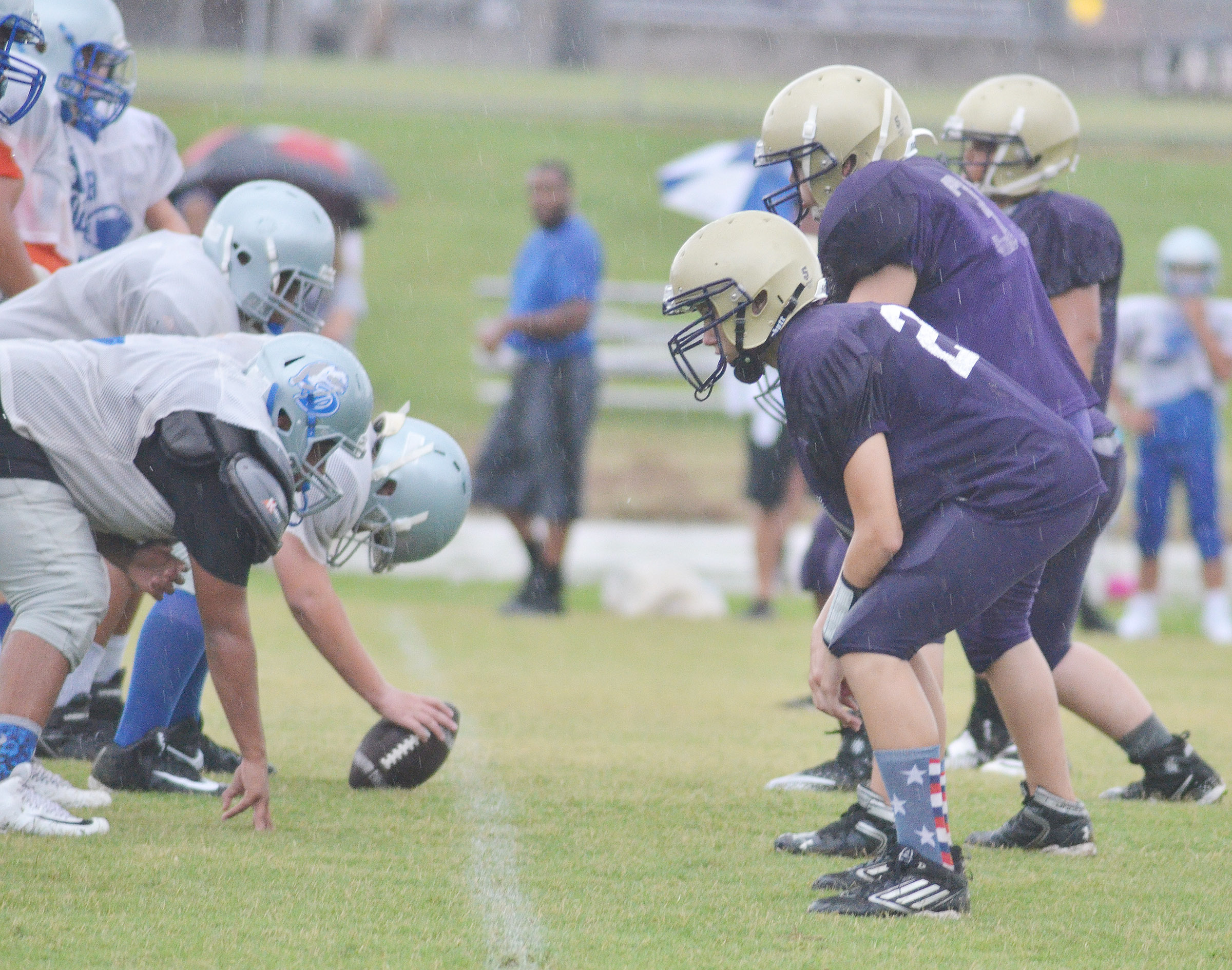 CMS defensive line players get ready for the snap.