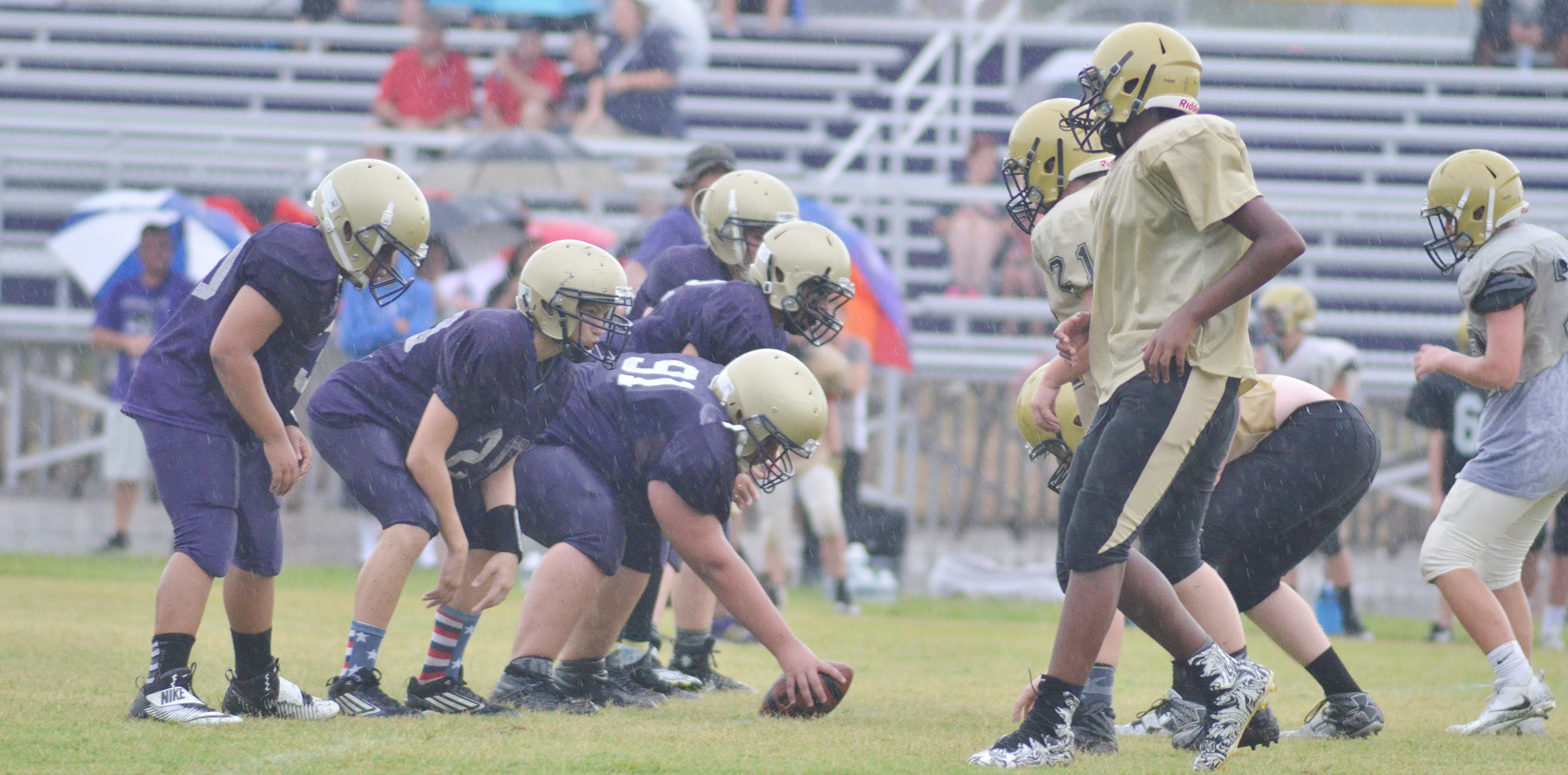 CMS offensive line players get ready for the play.