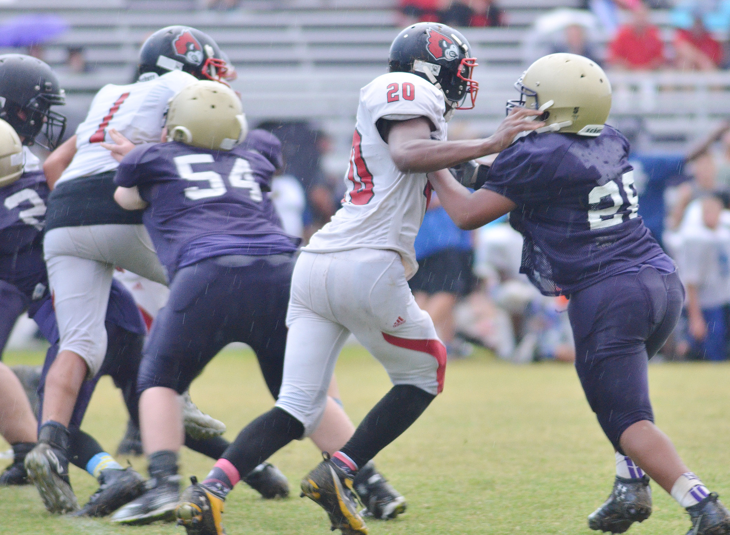 CMS seventh-graders Hayden Jones, at left, and Keondre Weathers tackle.