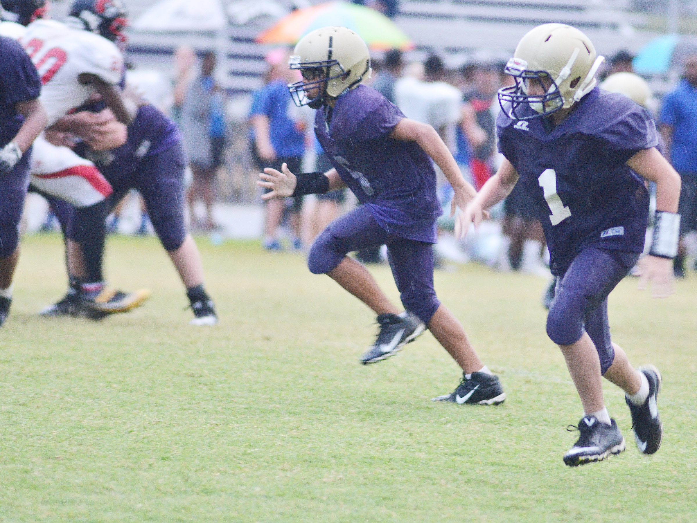 CMS eighth-grader Logan Phillips, at left, and eighth-grader Dakota Harris run.