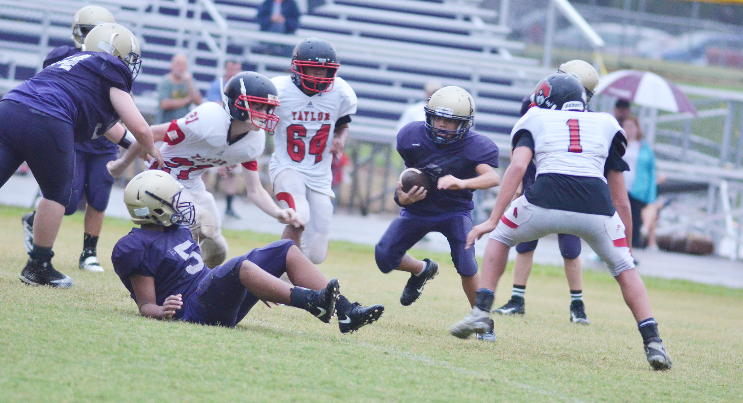 CMS eighth-grader Brice Spaw runs the ball.