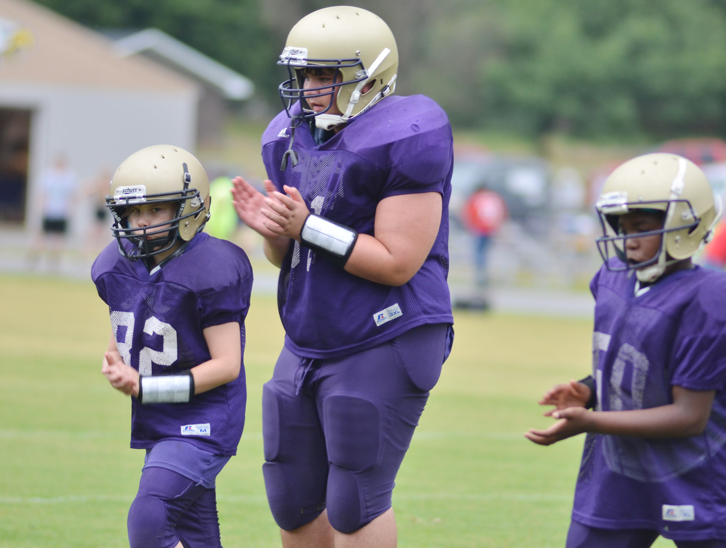 Campbellsville Elementary School fifth-grader Deason Smith runs during a warmup drill.