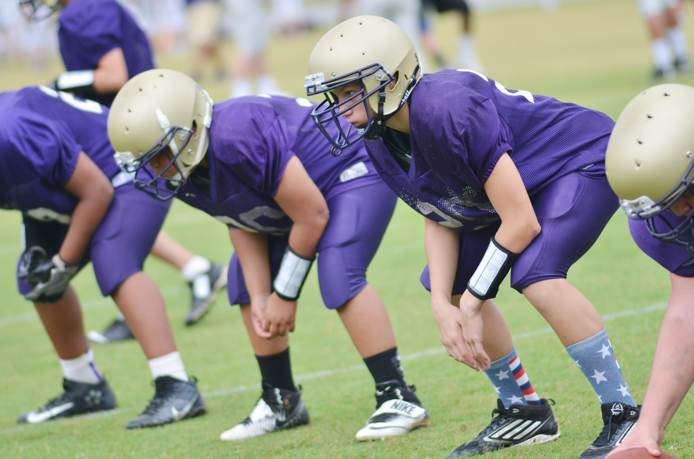 CMS seventh-grader Damon Johnson and his teammates get ready for a play.
