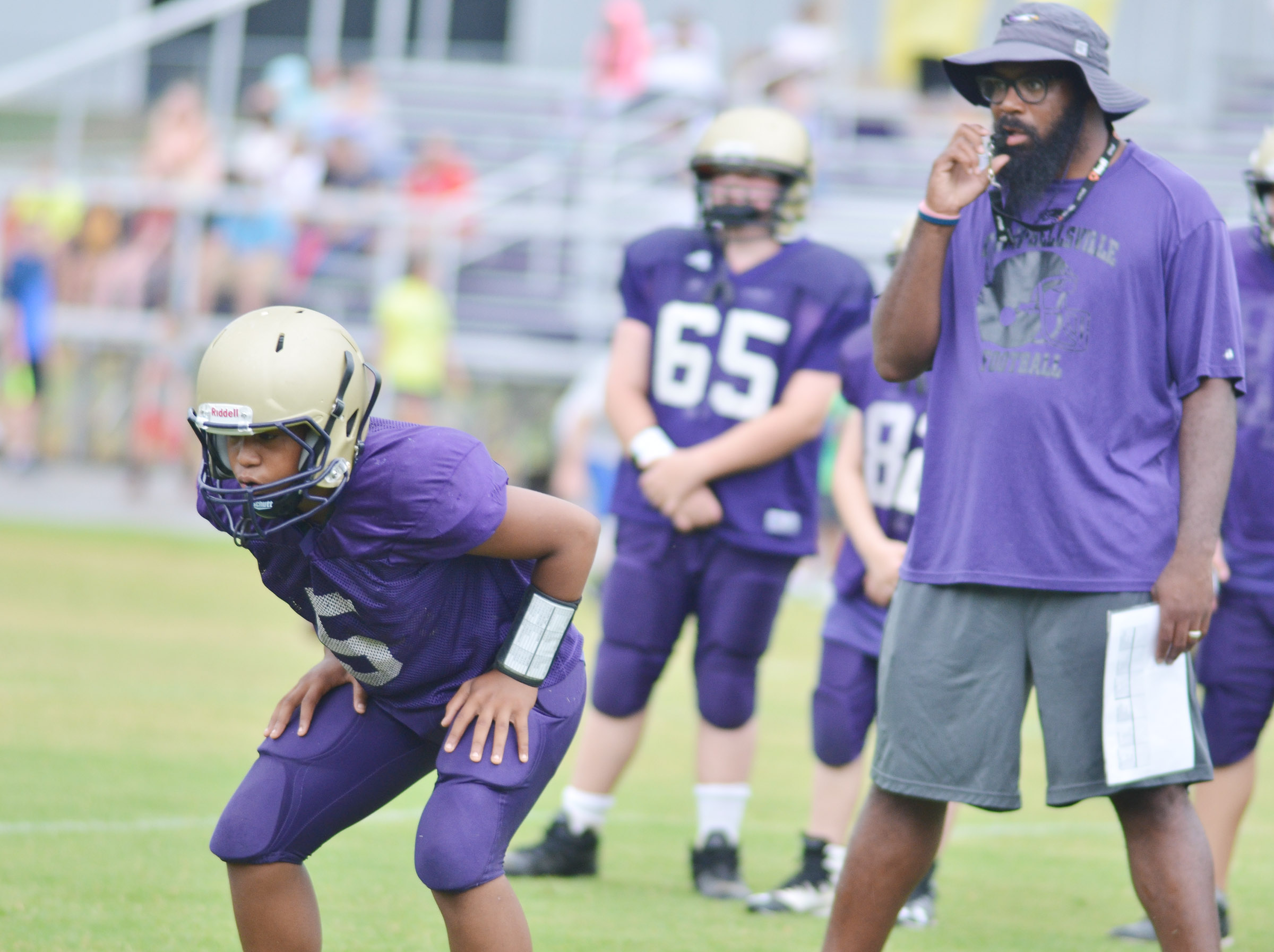 CMS seventh-grader Deondre Weathers gets set during a warmup drill with assistant coach Will Griffin.