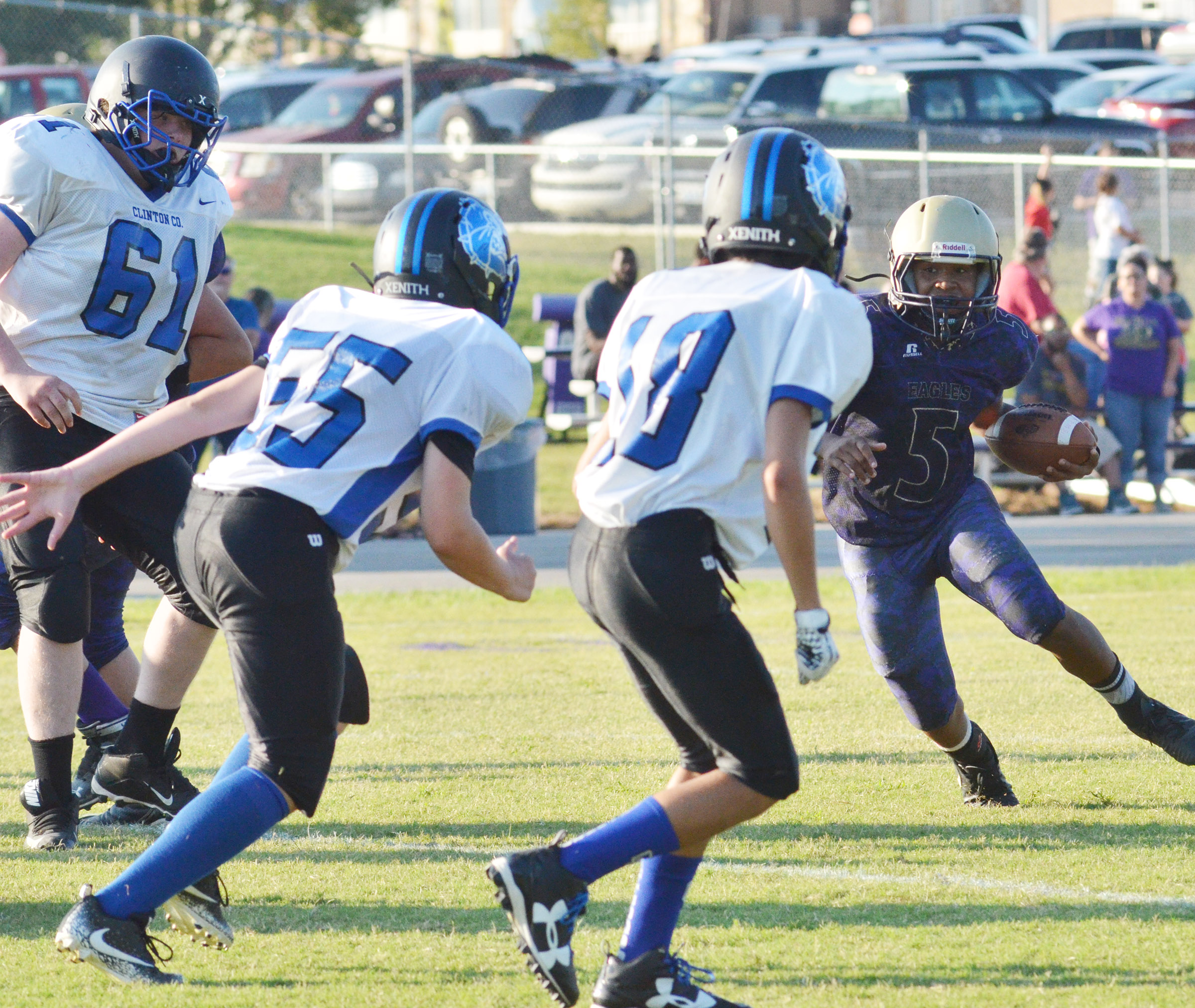 CMS seventh-grader Deondre Weathers runs away from the Clinton County defenders.