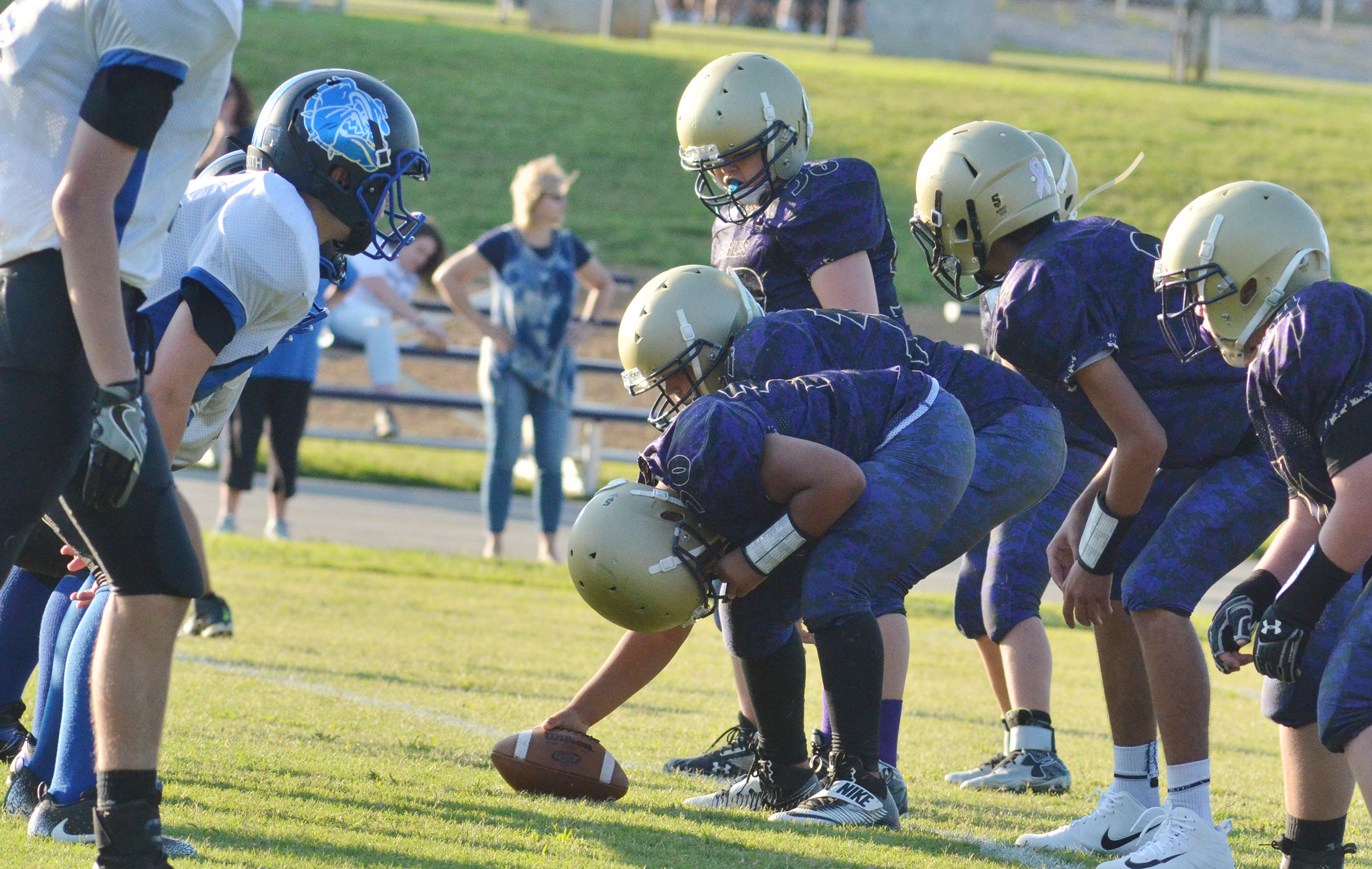 CMS offensive line players get set.