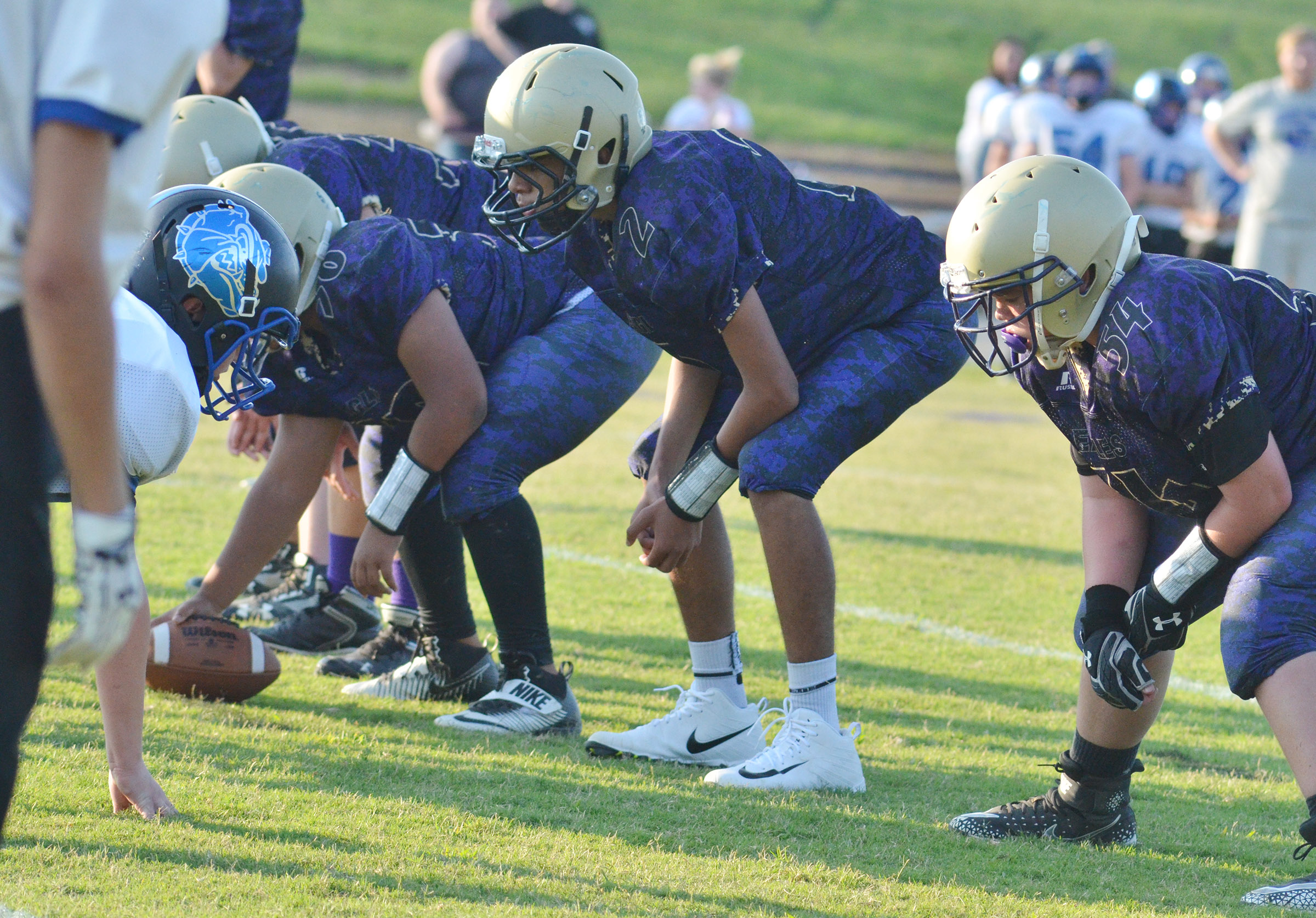 CMS eighth-grader Adrien Smith, center, and seventh-grader Hayden Jones get ready to block.