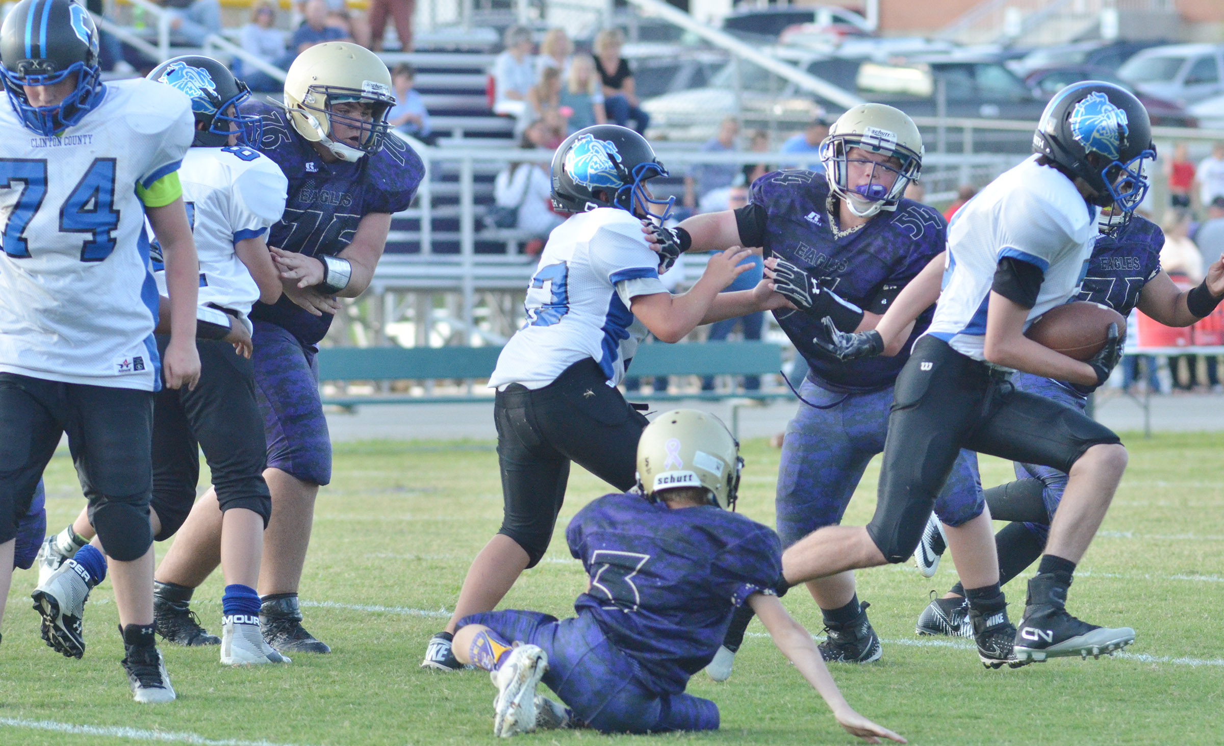 CMS eighth-grader Logan Rakes, at left, and seventh-grader Hayden Jones block.