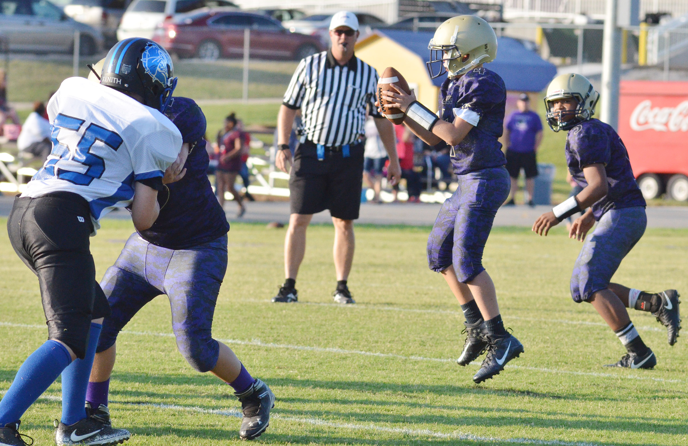 CMS seventh-grader Konner Forbis jumps to catch the ball.
