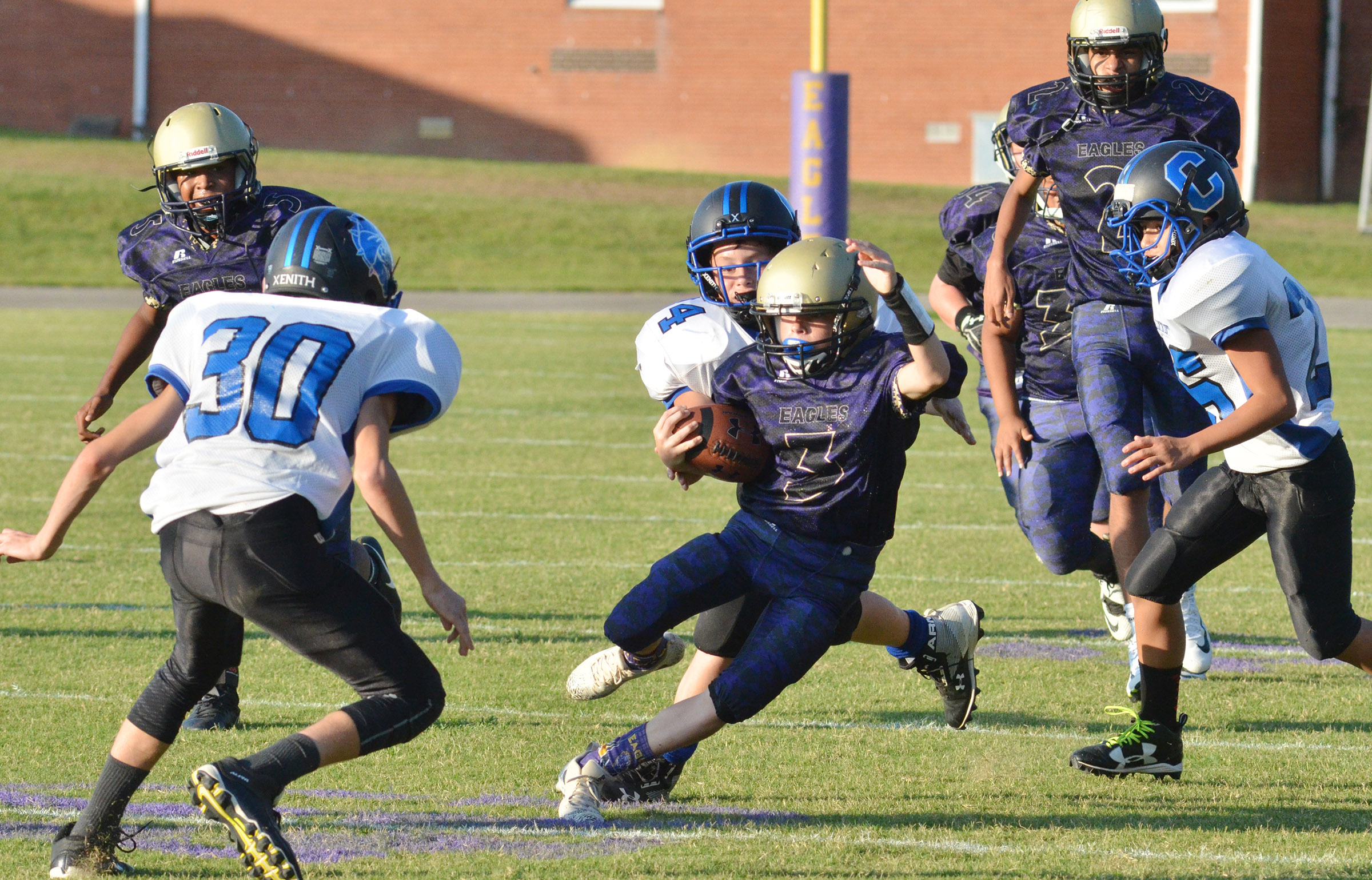 CMS eighth-grader Tuff Harper runs the ball.