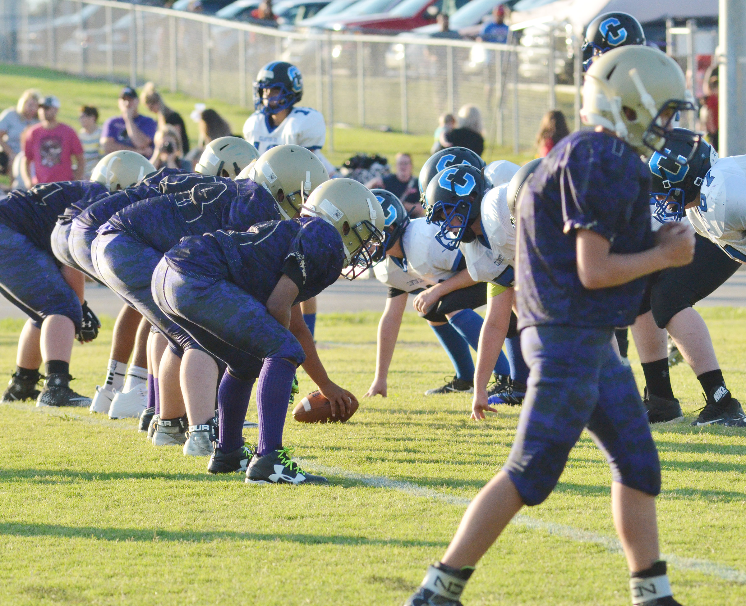 CMS offensive linemen get ready for a play.
