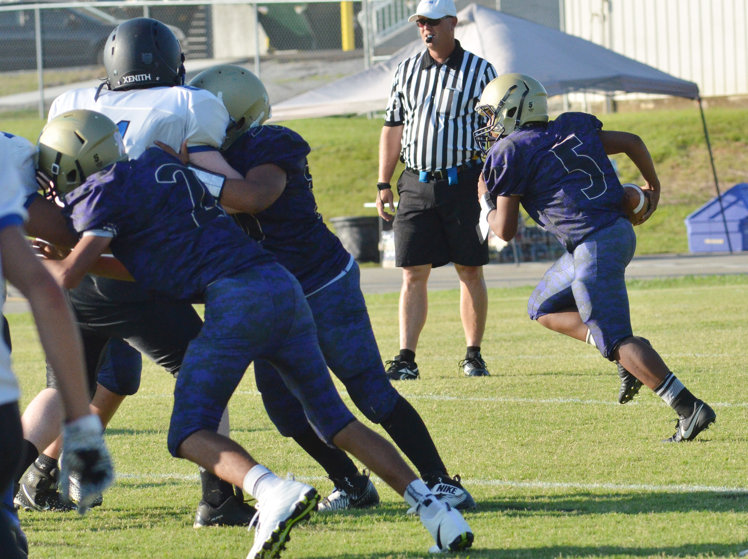 CMS seventh-grader Deondre Weathers runs the ball.