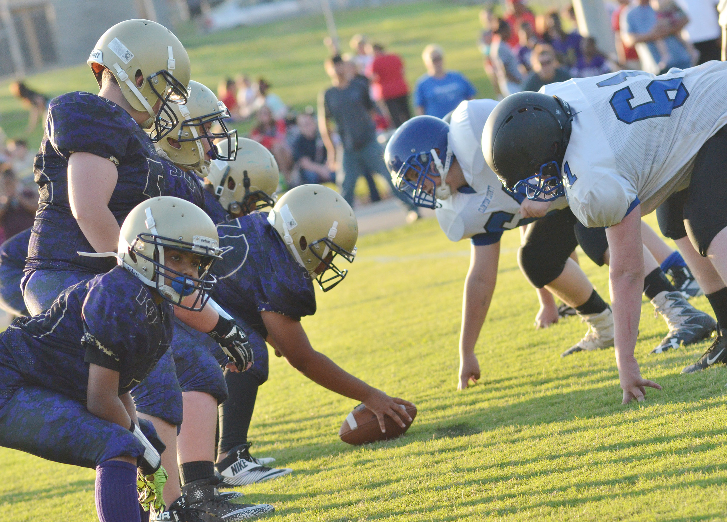CMS offensive linemen get ready for the tackle.