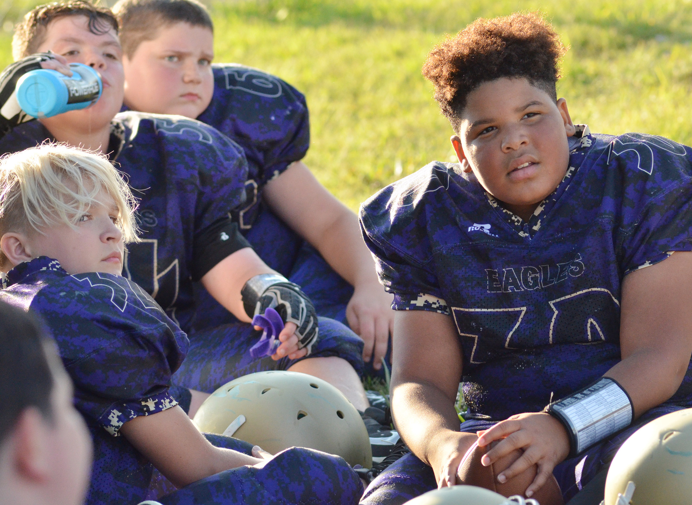 CMS sixth-grader Devin Kinser listens to his coaches during half-time.