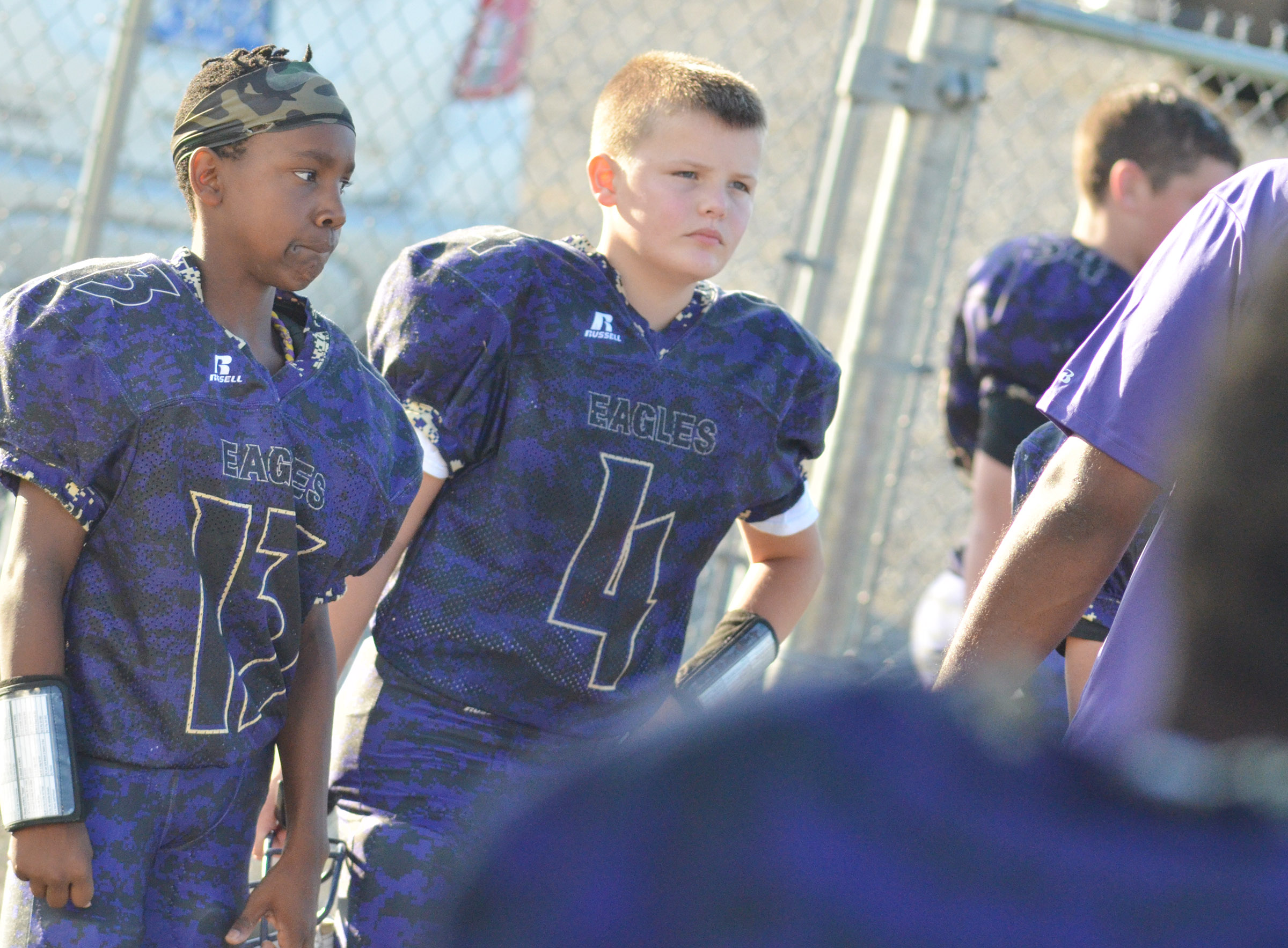 CMS eighth-grader Jadan Furman, at left, and seventh-grader Konner Forbis listen to their coaches during half-time.