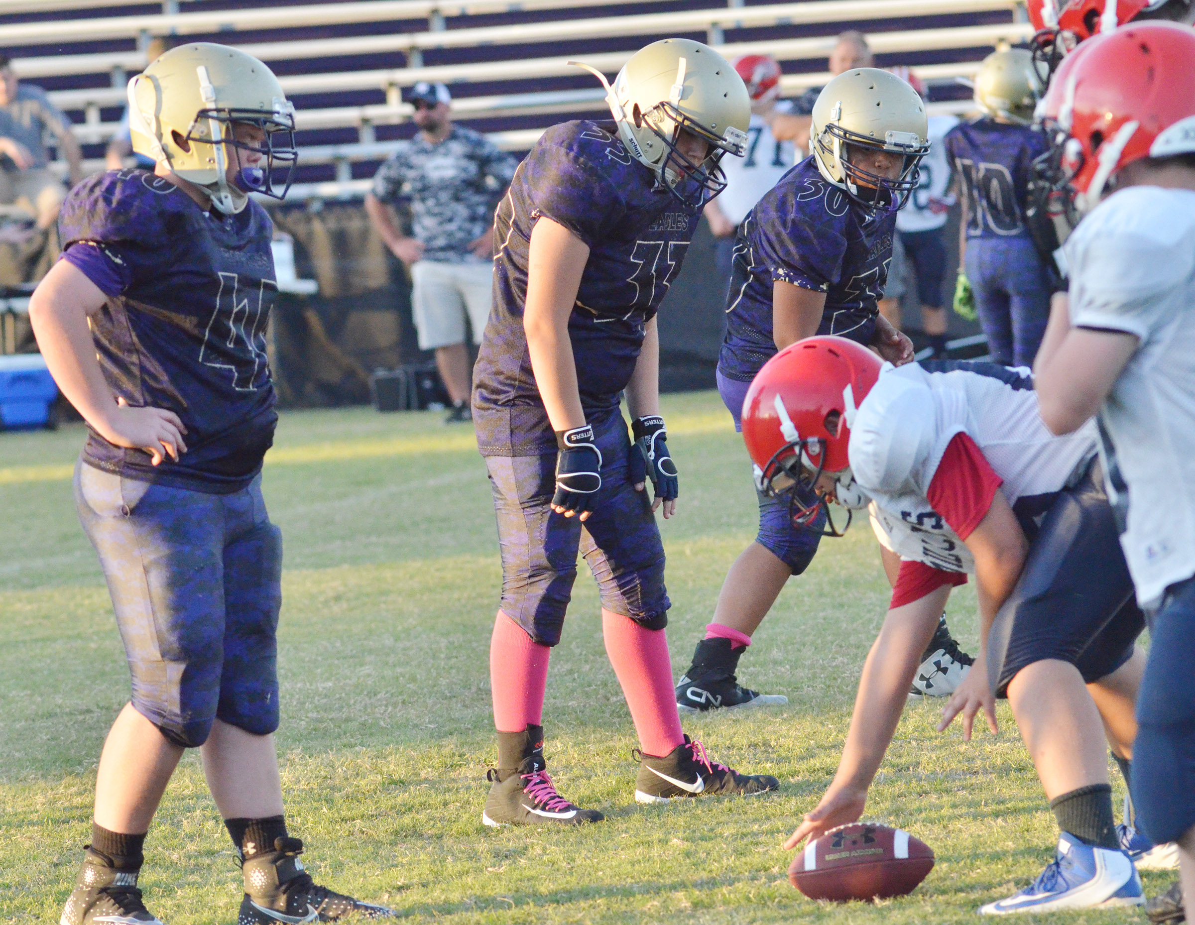 CMS seventh-grader Hayden Jones, at left, and his teammates get ready for the snap.