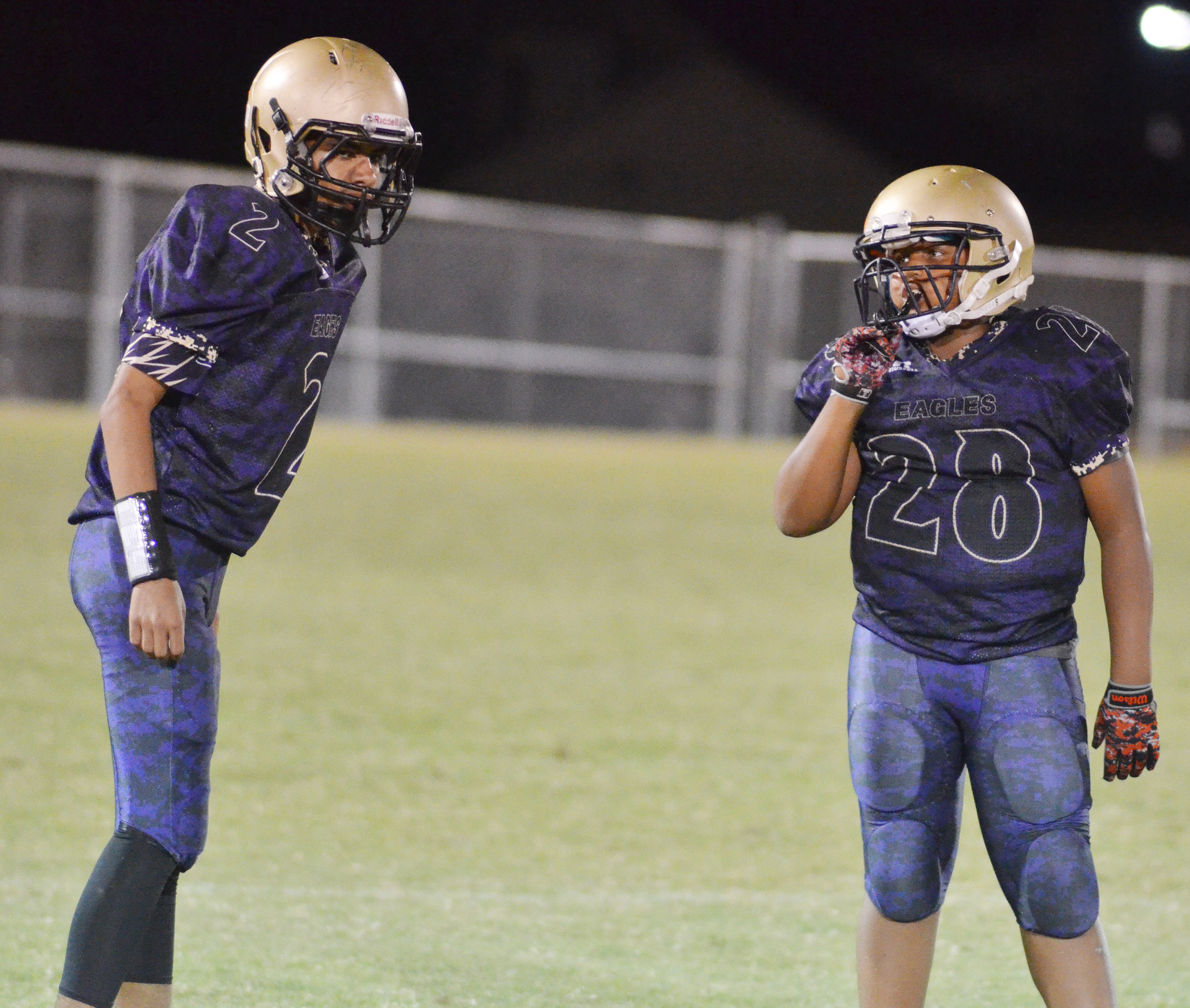 CMS eighth-grader Adrien Smith, at left, and seventh-grader Keondre Weathers talk before a play.