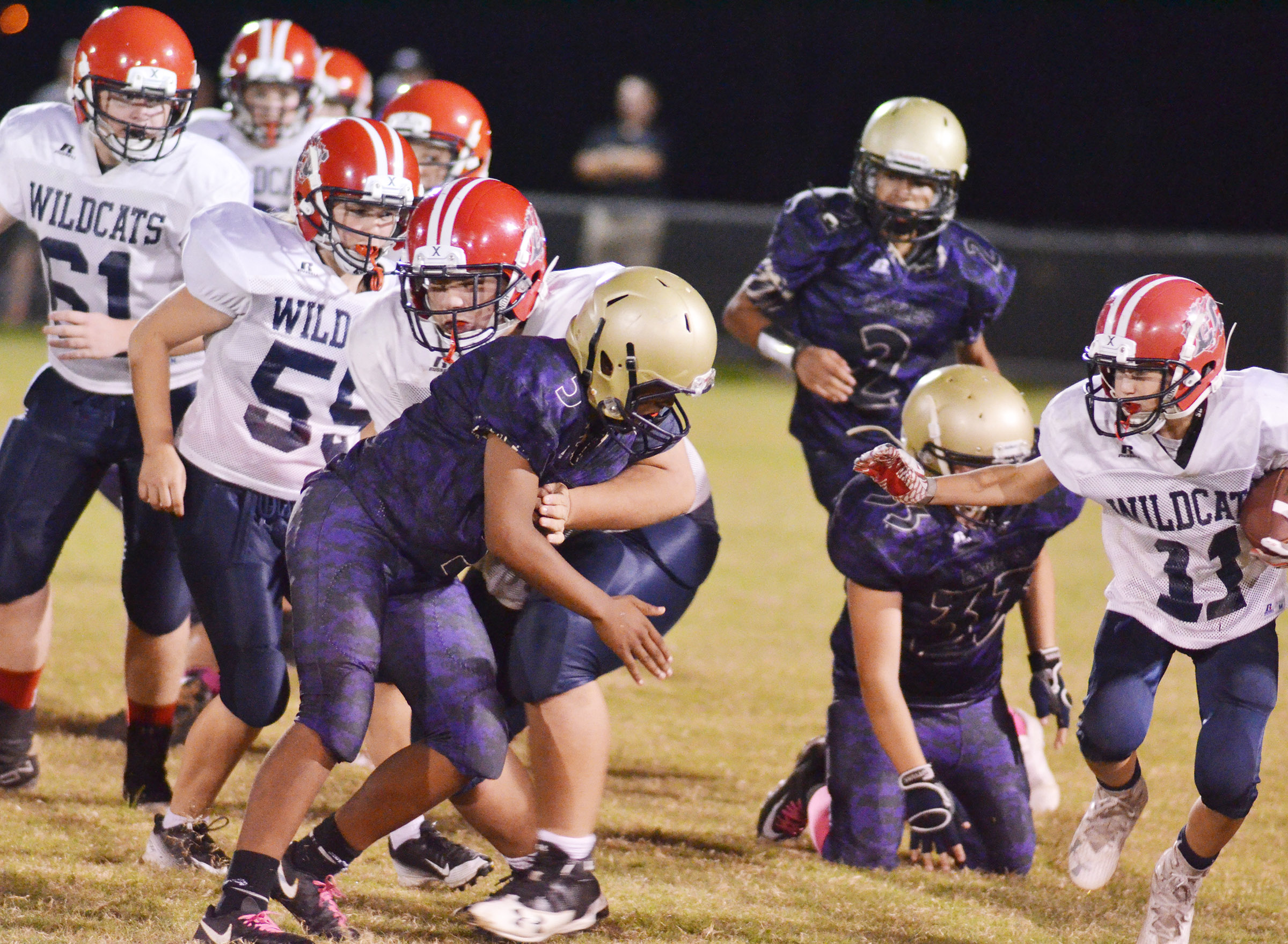 CMS players tackle.