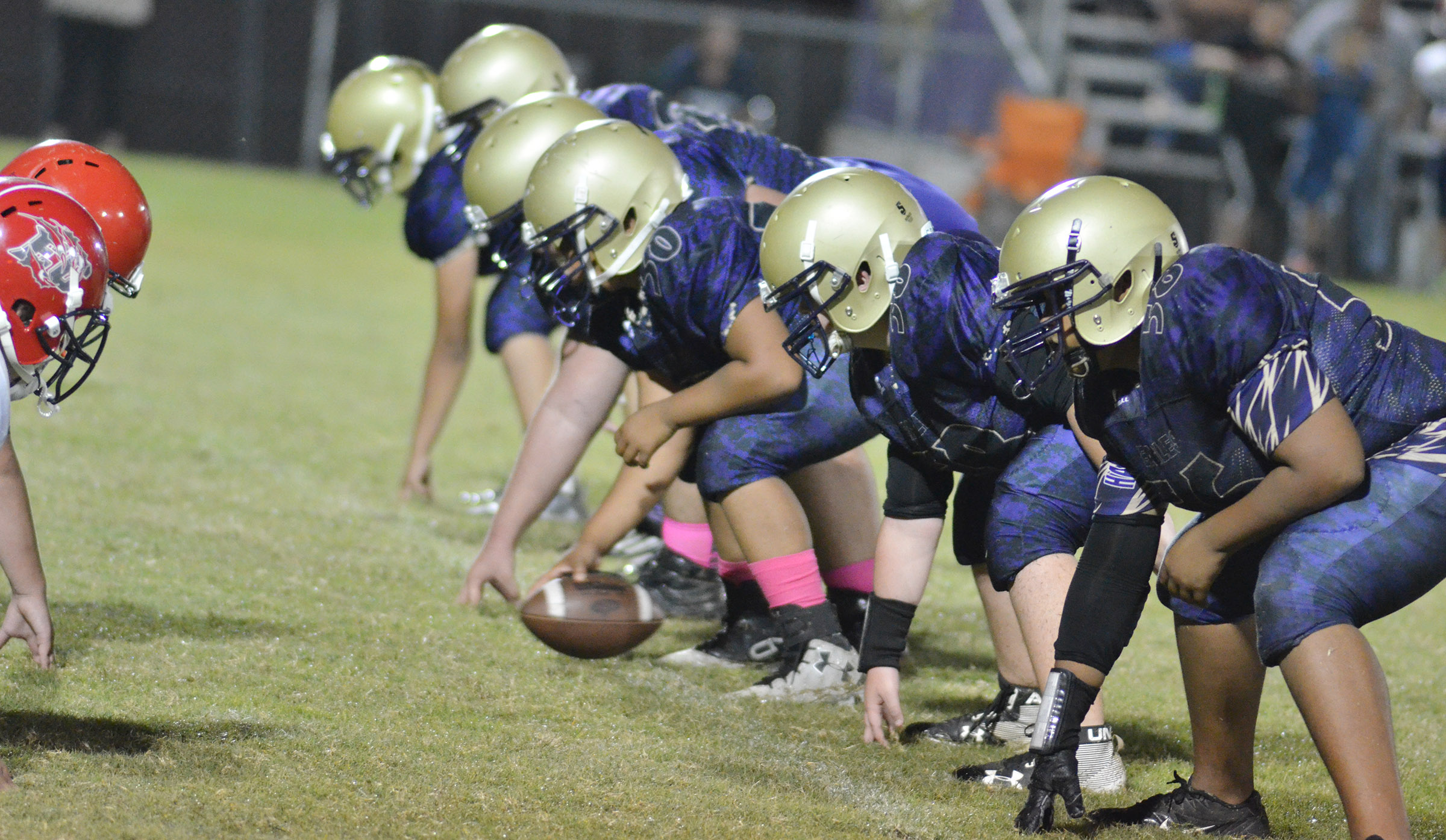 CMS offensive players get ready to tackle.