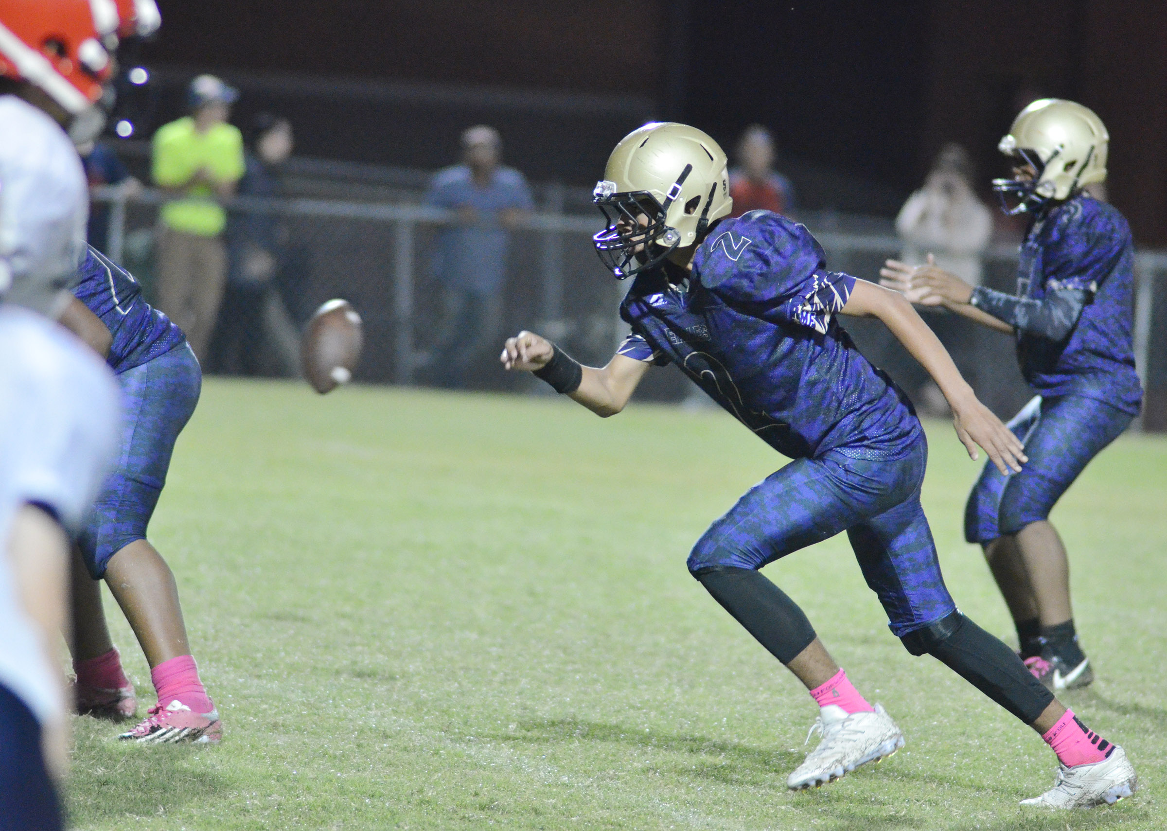 CMS eighth-grader Adrien Smith runs after the snap.