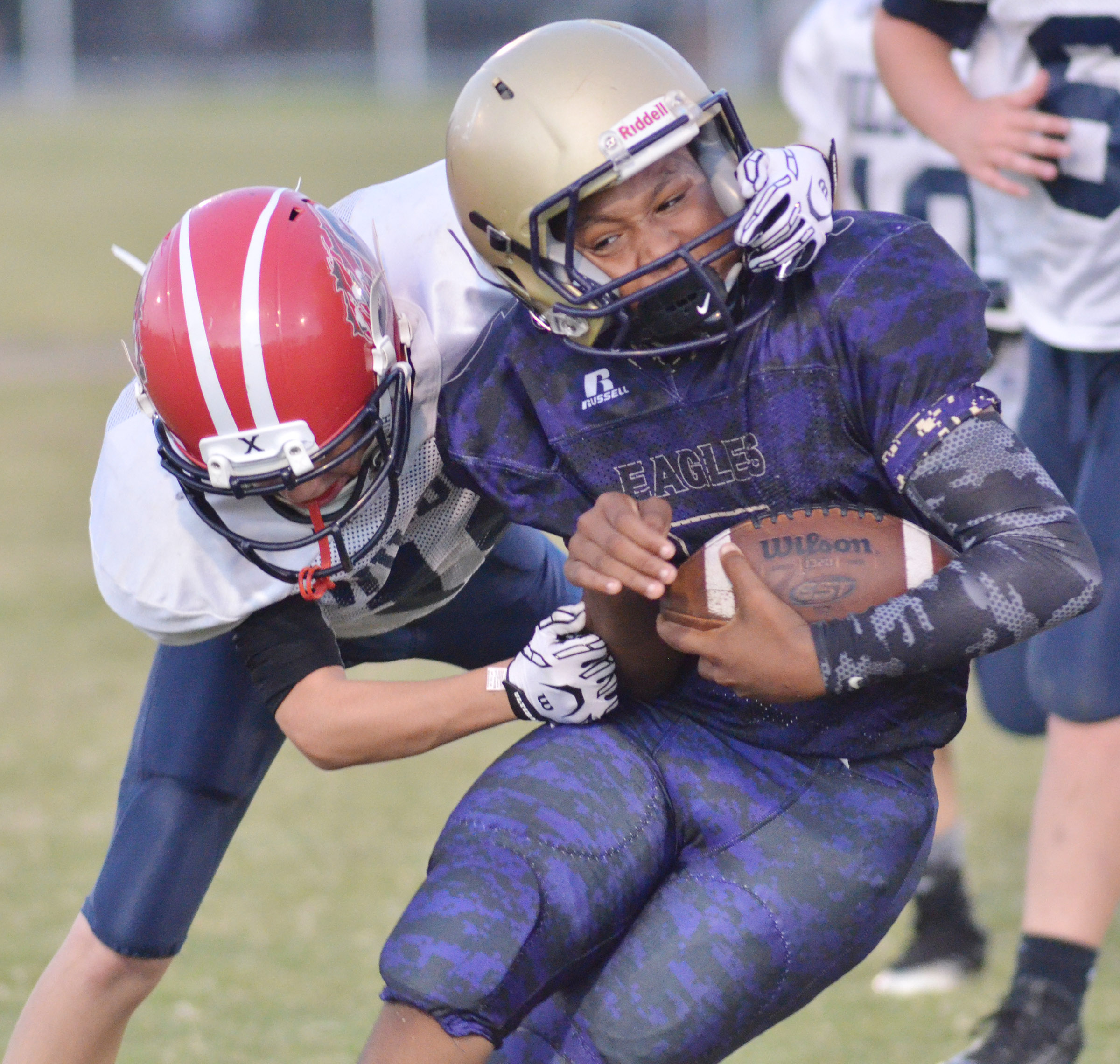 CMS seventh-grader Deondre Weathers runs as an Edmonson County player attempts to tackle him.